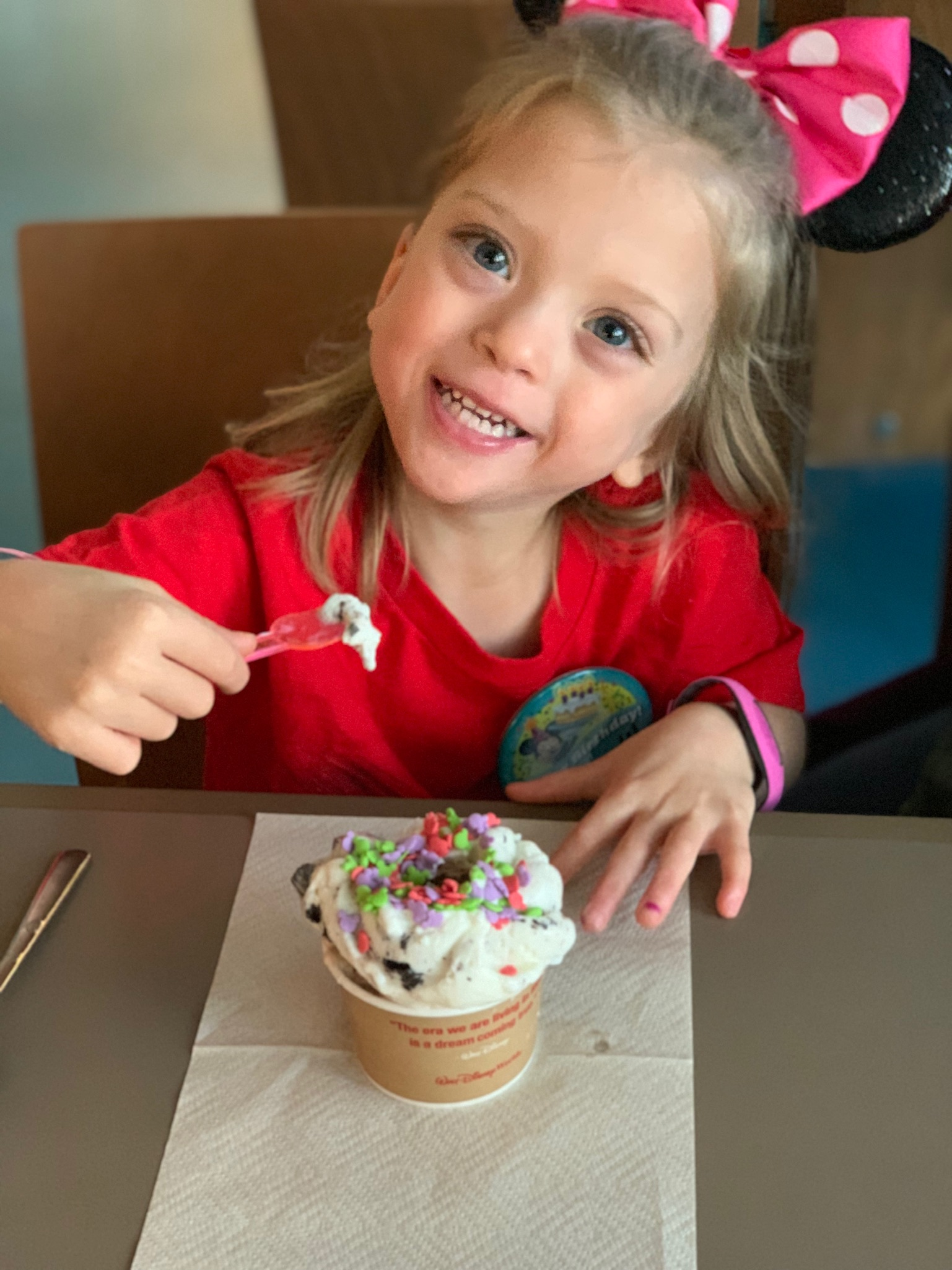 Lucie wore a button every day that said Happy Birthday and she'd get fun add ons from the Cast Members at Disney, like a pink balloon, and fun sprinkles. Sundaes at lunch? Yes, please!