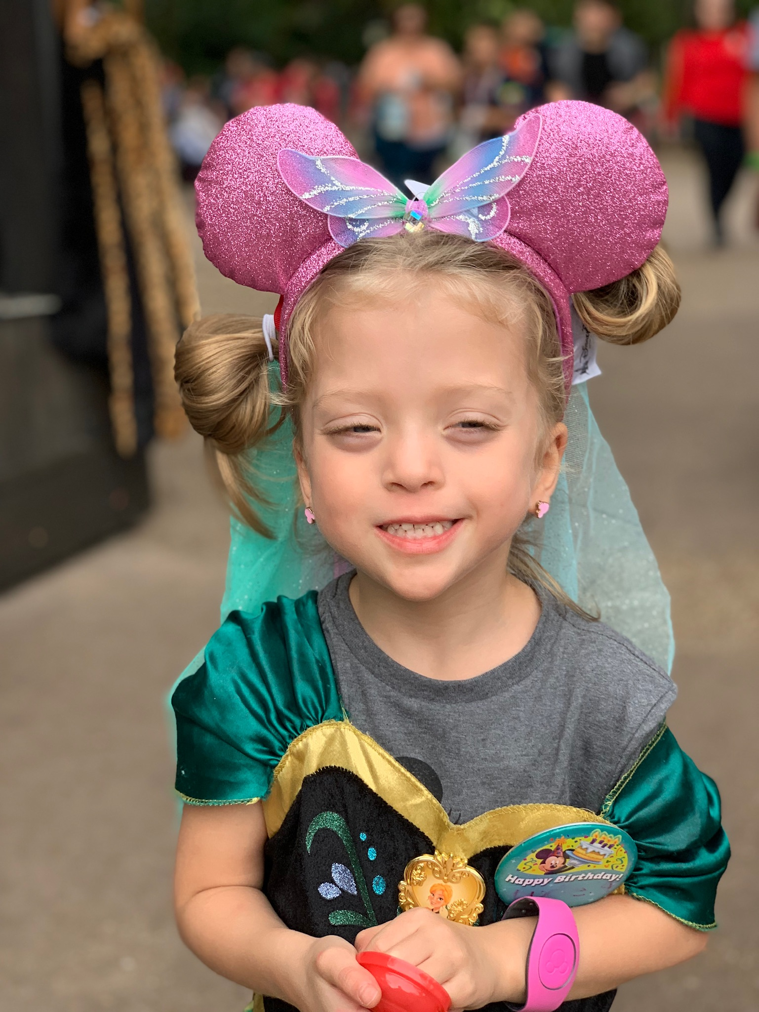 Trying on all the Minnie Ears.