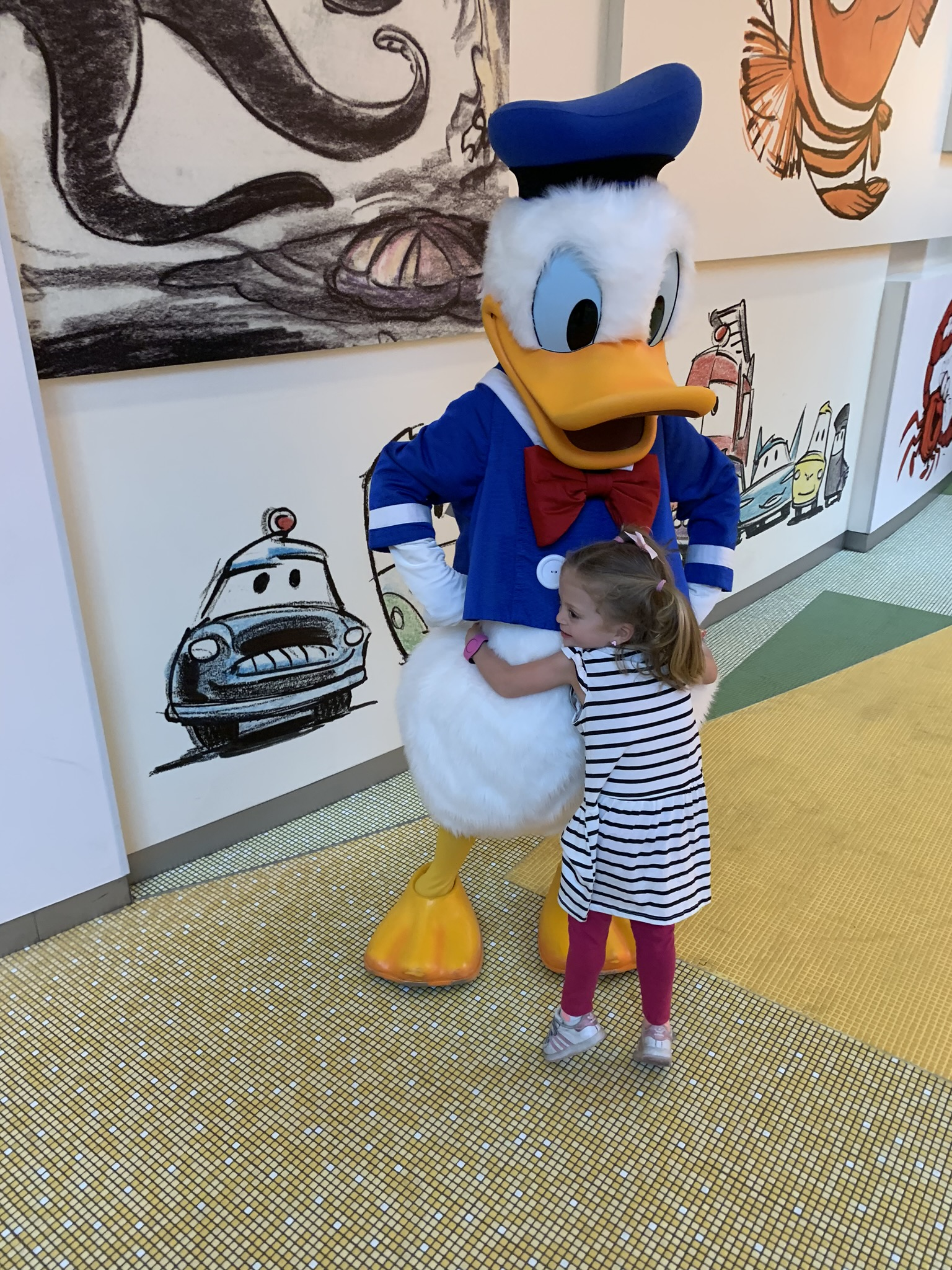 Back at the hotel as they were checking out, Robby and Lucie ran into Donald...