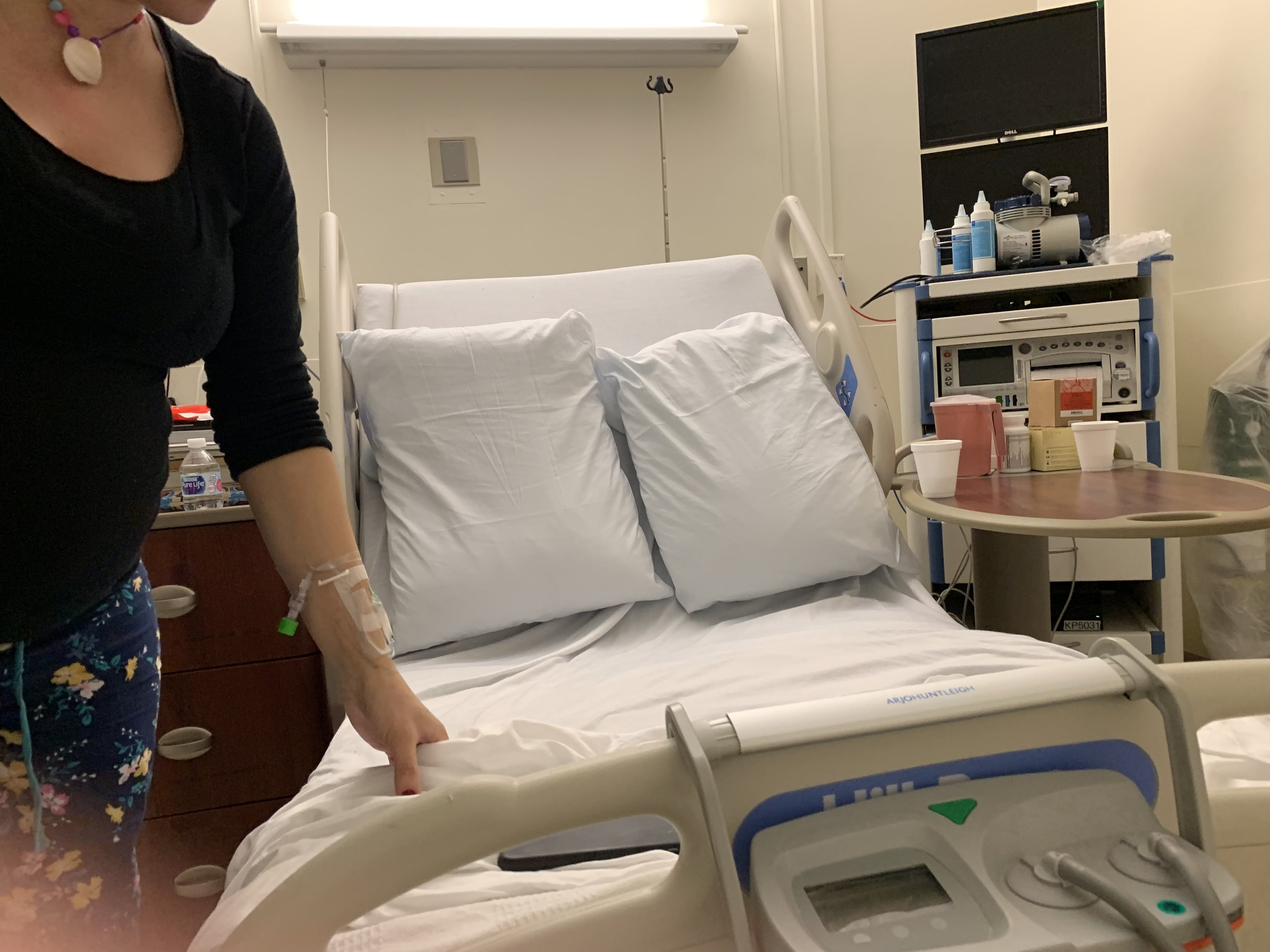 Lucie took this candid of me making the hospital bed. I thought it was a cool perspective.
