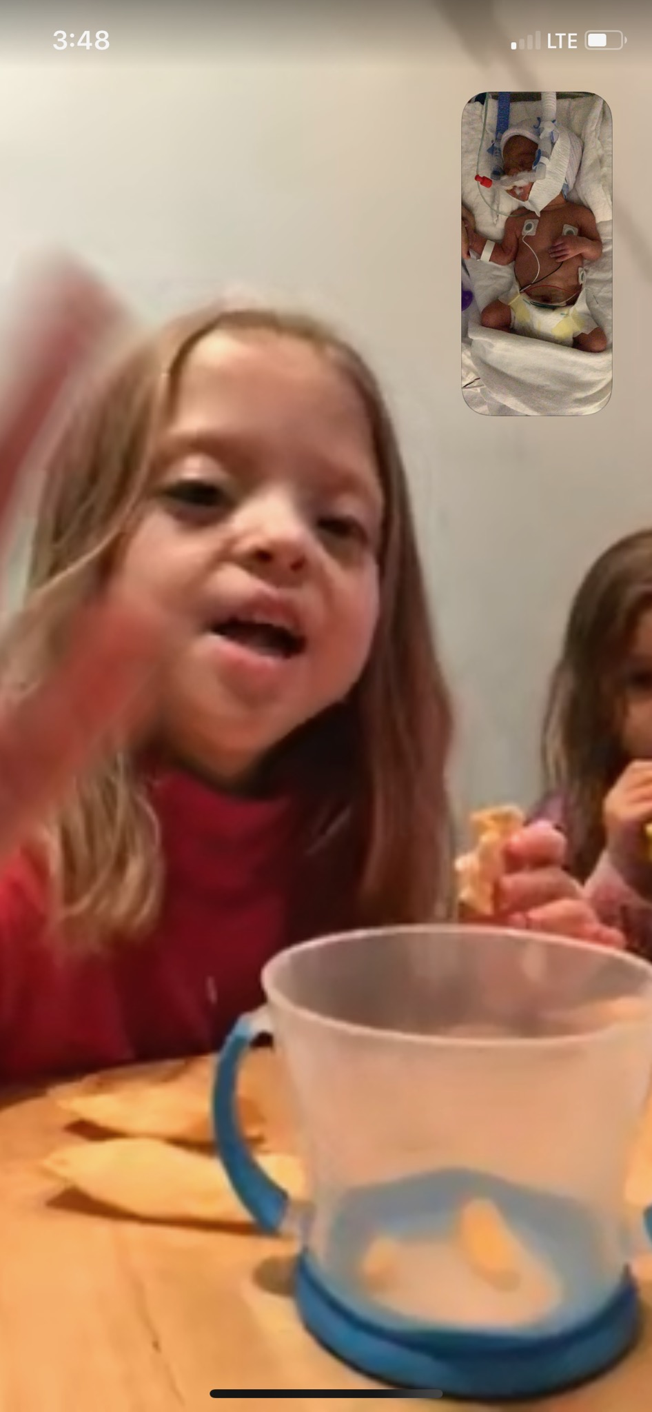 Big sis saying hi to her little sis thanks to technology. Hoping they'll get to meet later this week in person.