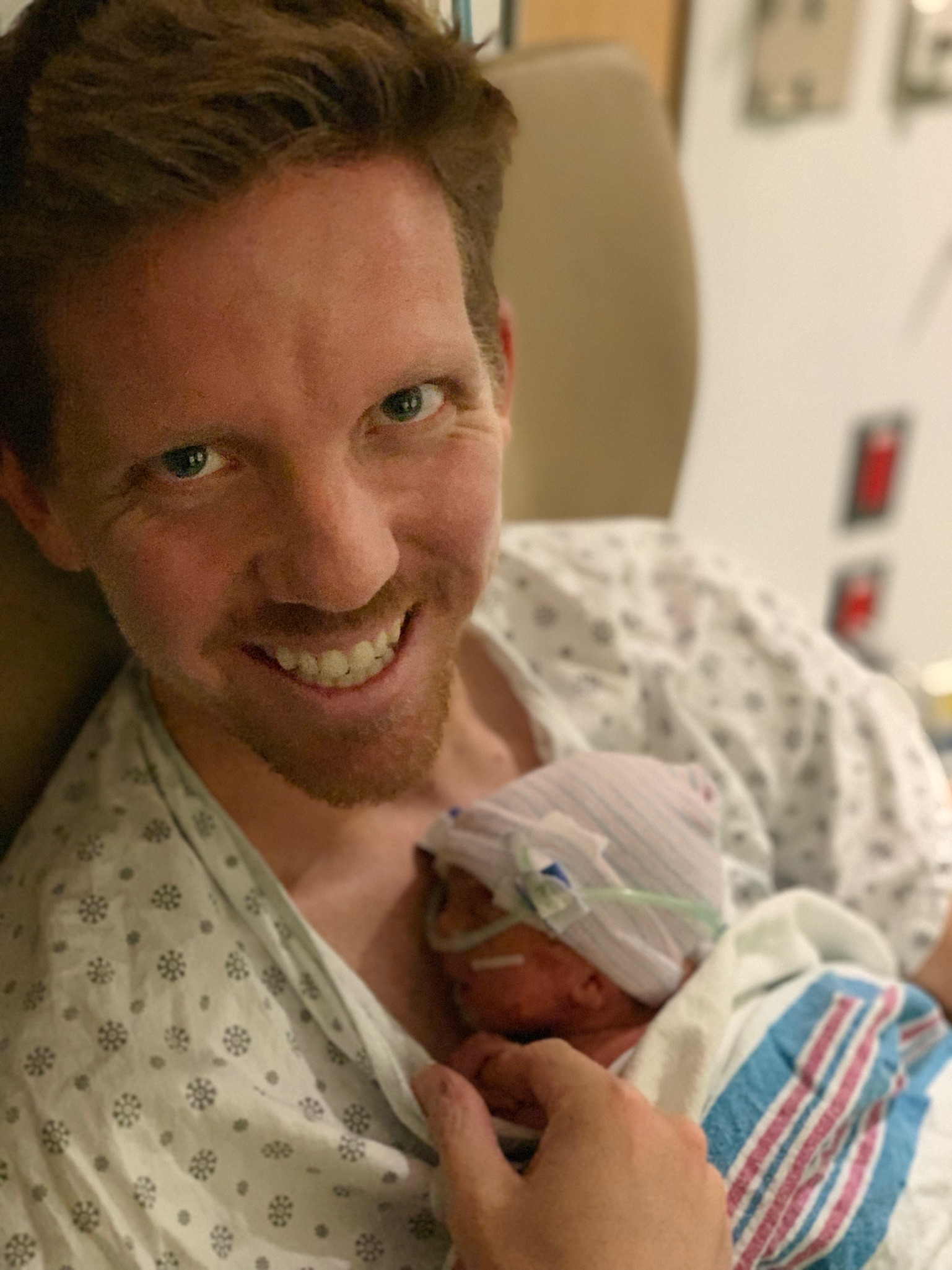 Daddy getting to hold his littlest love.