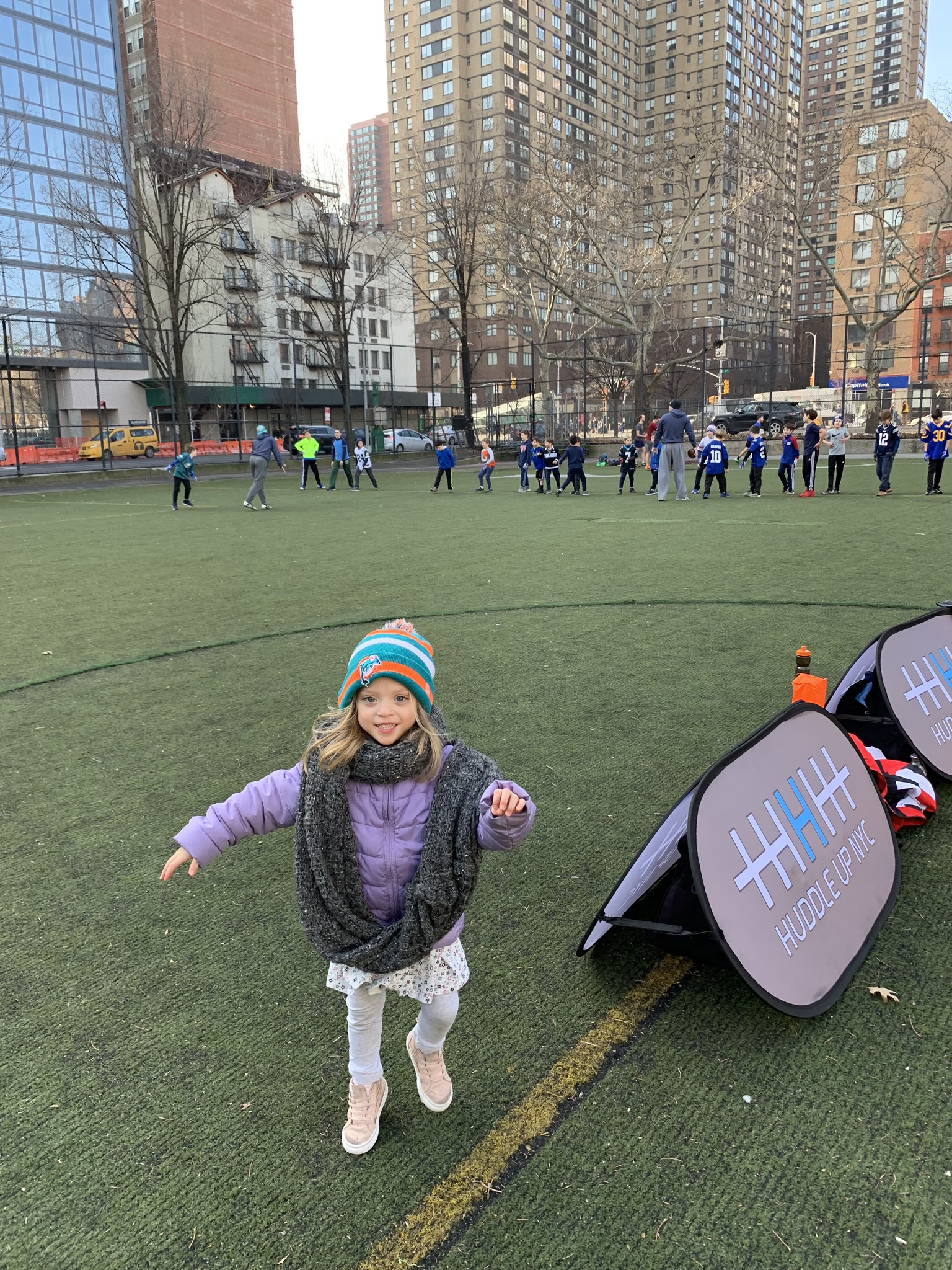 So proud of her Dad the coach! If you ask her what Daddy's favorite football team is, now she says: Huddle Up NYC! =)