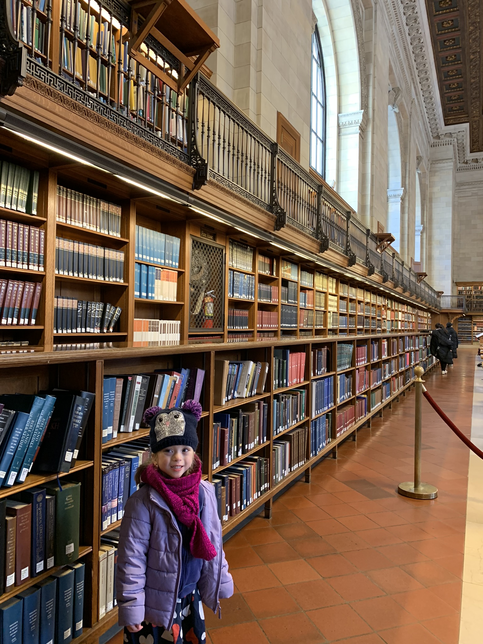 ... and then took her to the research floor with the grand hall of books. We had recently watched  Beauty and the Beast  so it was fun to show her the big bookshelves like in the castle.