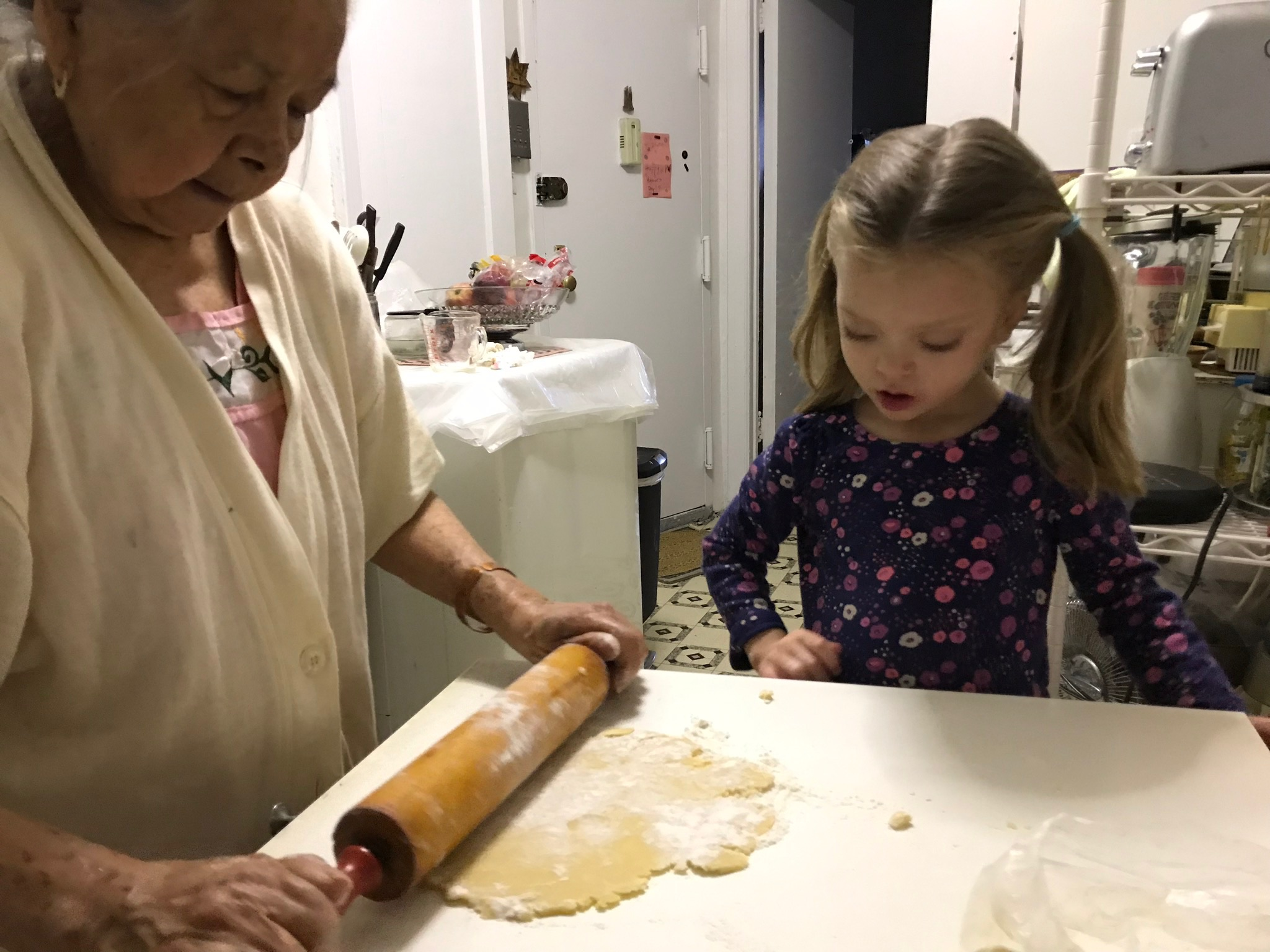 Lucie making cookies with Aly and our neighbor, Pilar.