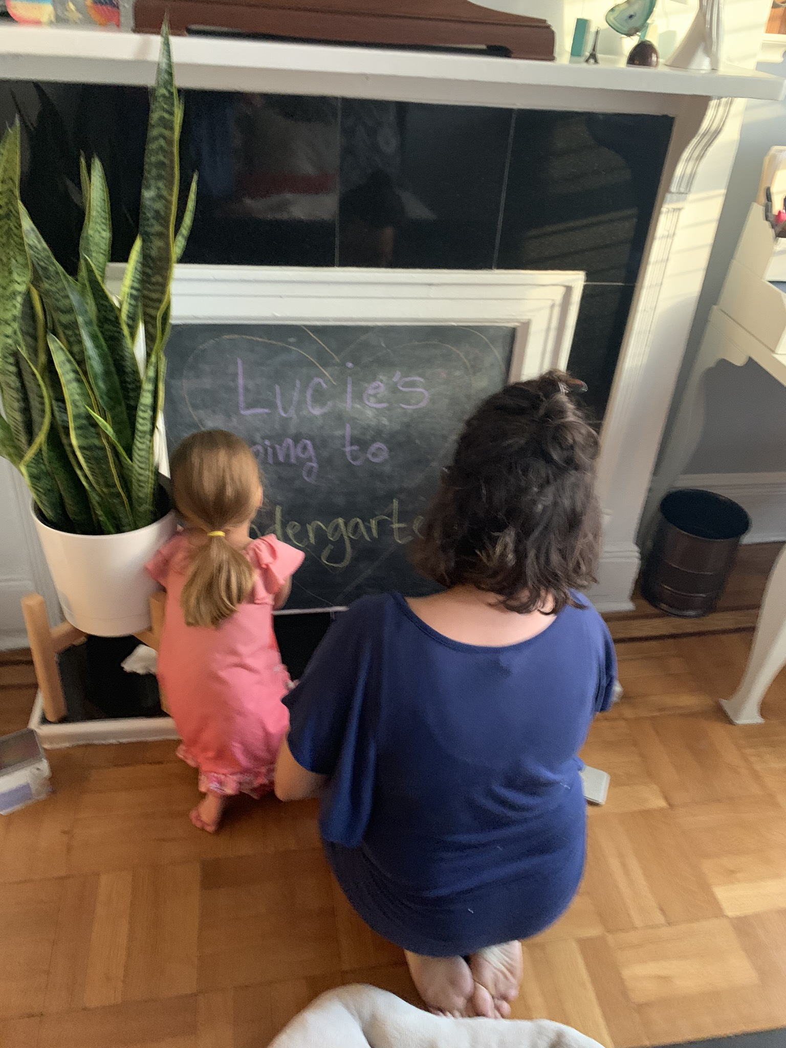 Getting the chalkboard ready for tomorrow's big day: Lucie's going to Kindergarten