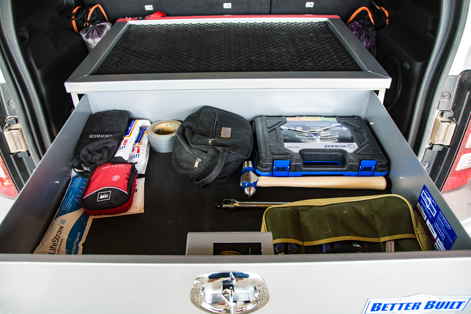 Here's the drawer reloaded and fully opened. We have additional equipment in mind and plenty of room for it. As you can see there's also room for soft items between the sides of the unit and the sides of the vehicle.