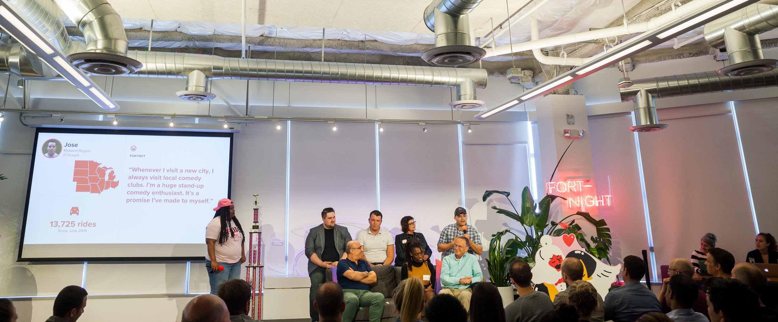 The DAC on stage presenting at Lyft's all-hands company meeting