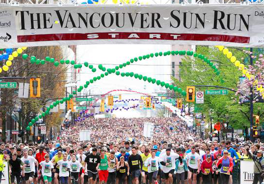 Runners at the Vancouver Sun Run April 14. a 10k run through downtown Vancouver with Symmetrix.