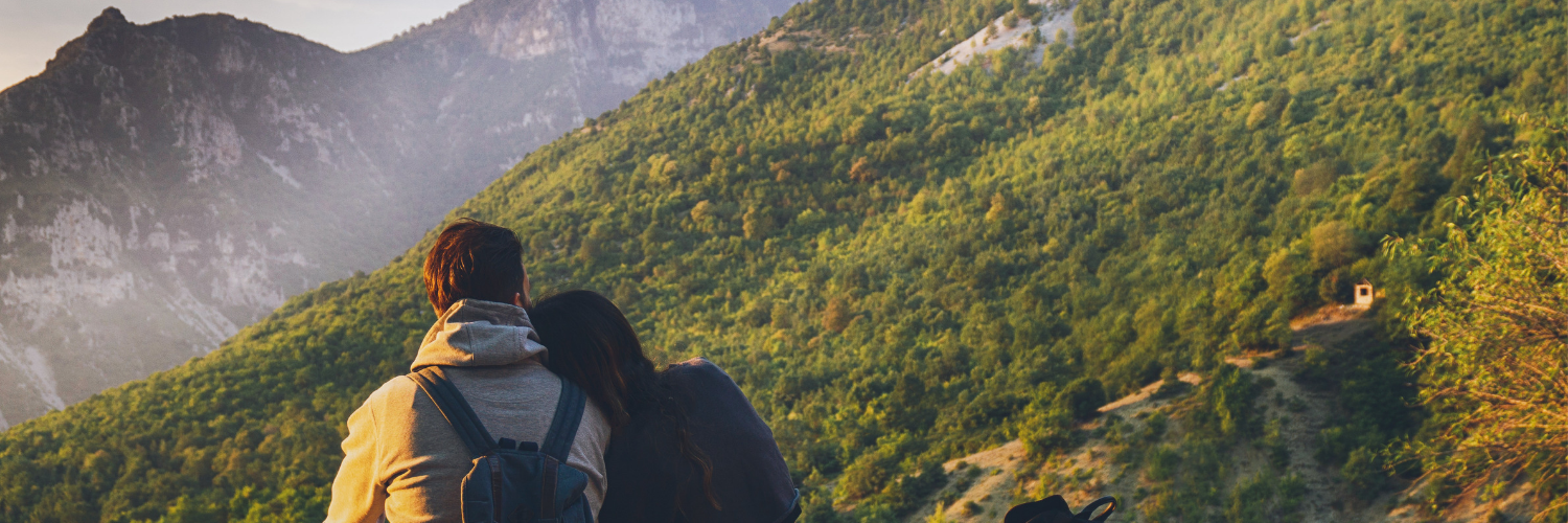 couple with brown hair looking at a mountain while hiking in Vancouver.