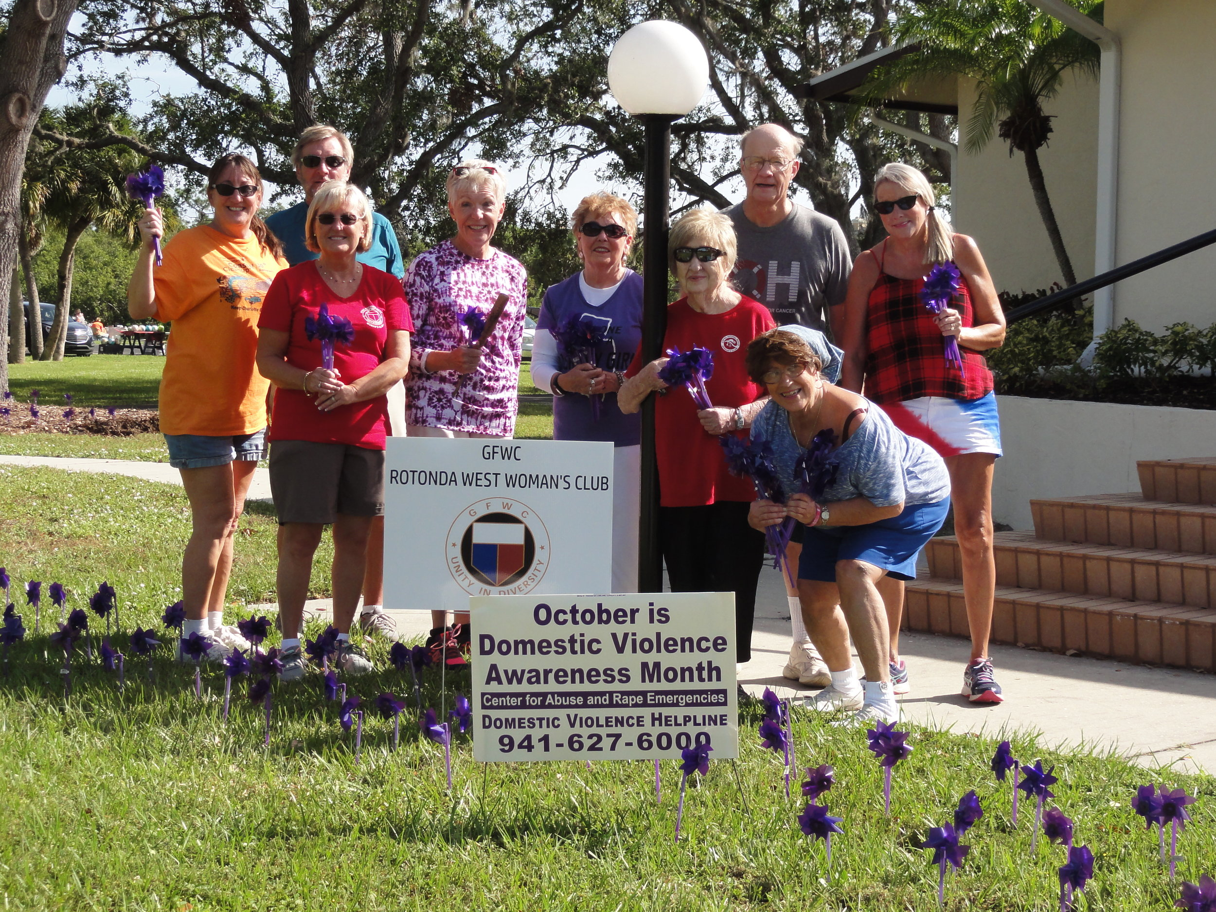 GFWC RWWC purple pinwheels - On Saturday Oct. 21st, we put our Domestic Violence Awareness purple pinwheels on Rotonda West Blvd in front of the Faith Lutheran Church & Rotonda West Community Church. Thanks to Everyone that helped !!!