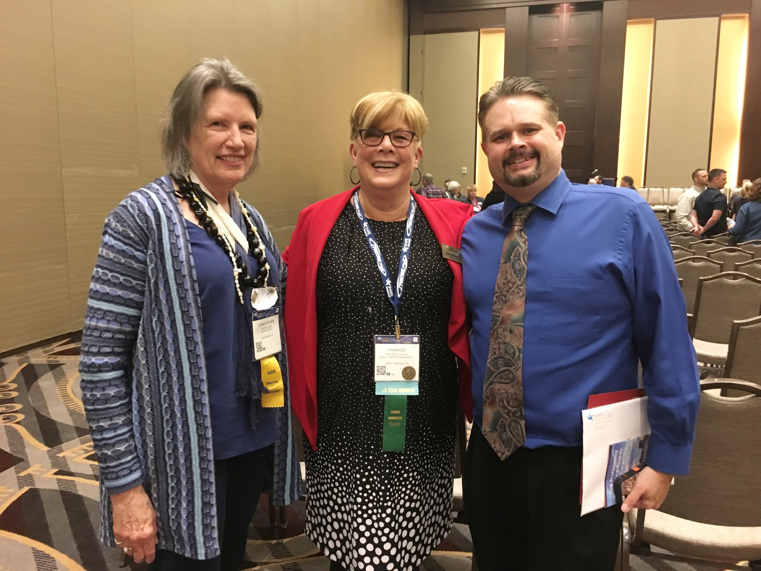 SHAPE America President Fran Cleland flanked by Dorothy Orr, SHAPE Alaska's Executive Director and Honor Award Winner, and Bill Pugh, Anchorage Physical Educator and AHA/Jump Rope for Heart grant winner. (Photo taken at Honor Awards Ceremony, SHAPE America Convention in Nashville, TN. March 2018)