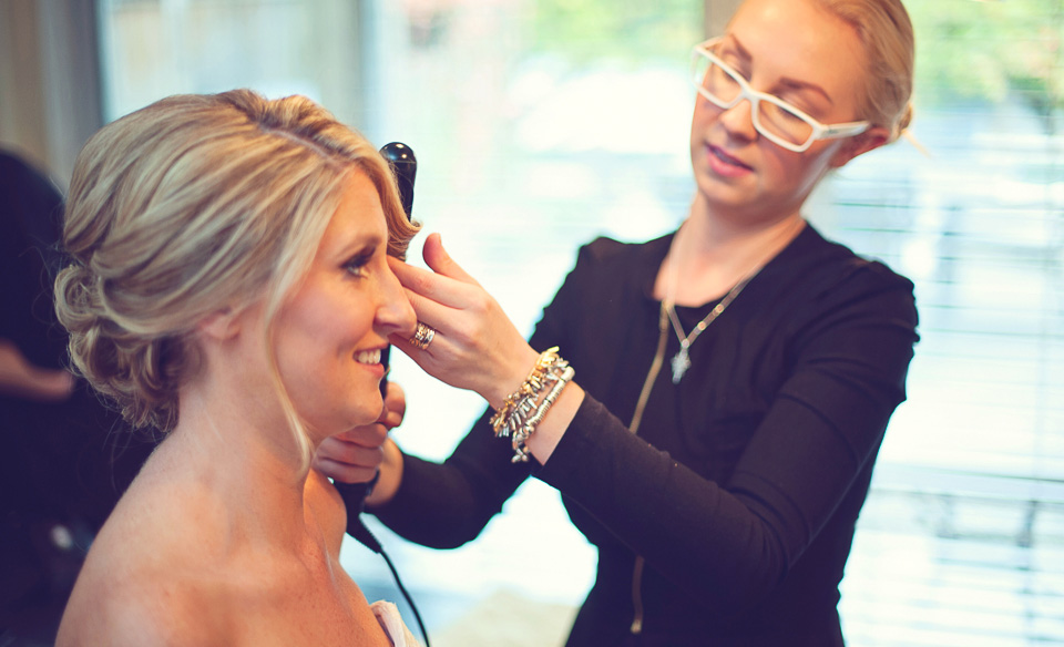BE Studio's Brianna Errelat adds the final wave to Suzie's gorgeous wedding day look. Photo credit: Vasia Photography