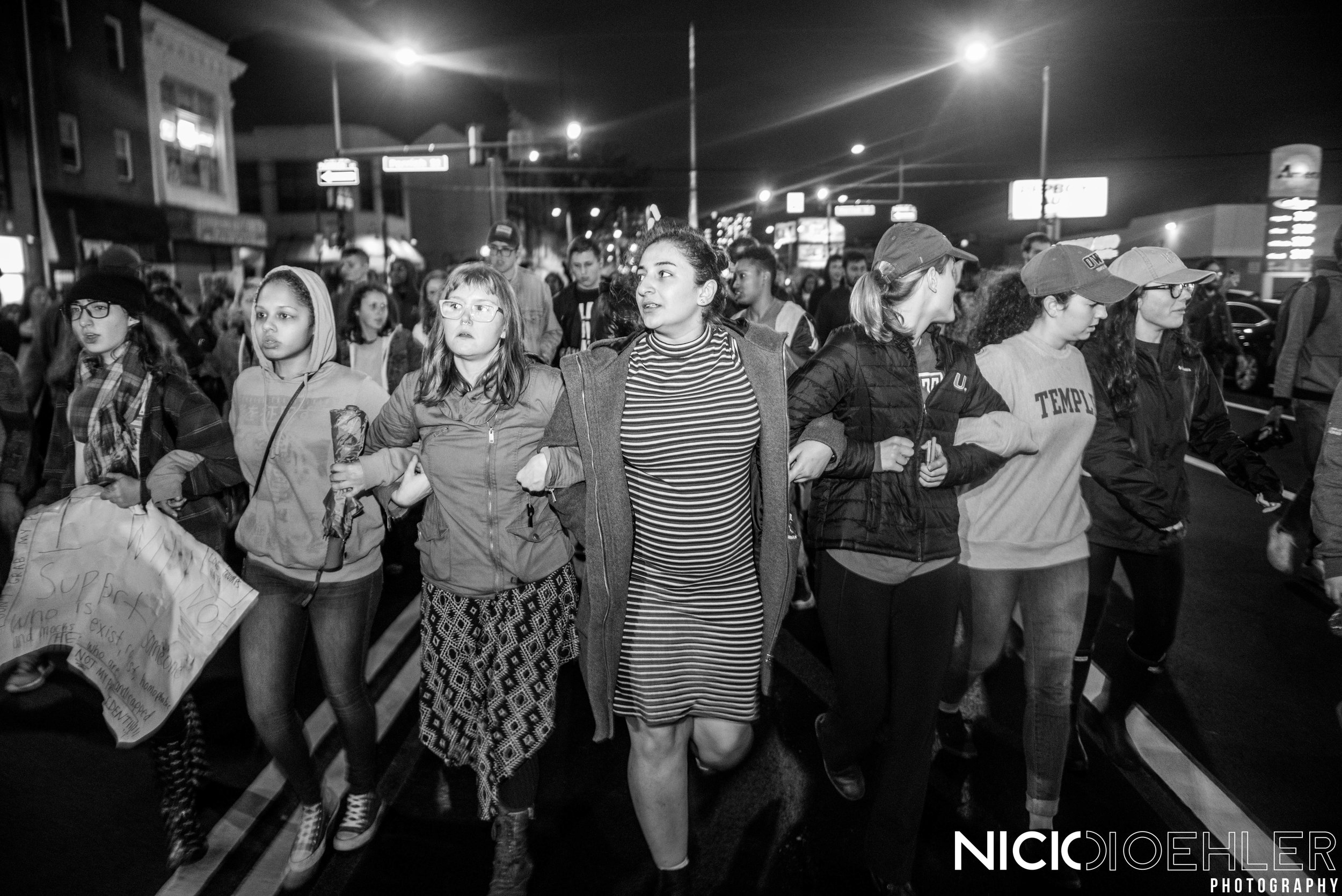 Protestors march through the streets with locked arms.
