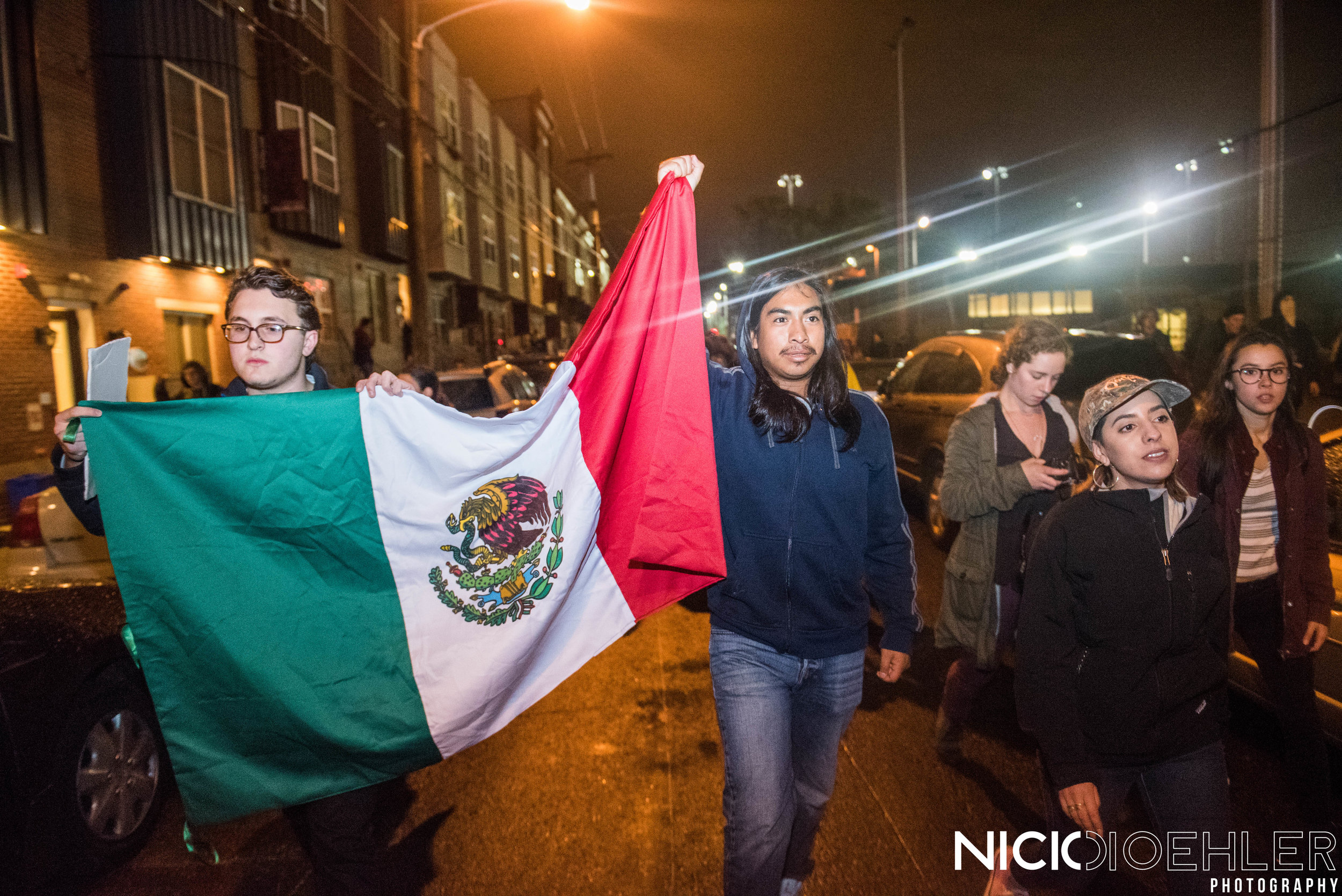 Mexican flag being held up by protesters on way back to Center City Philadelphia.