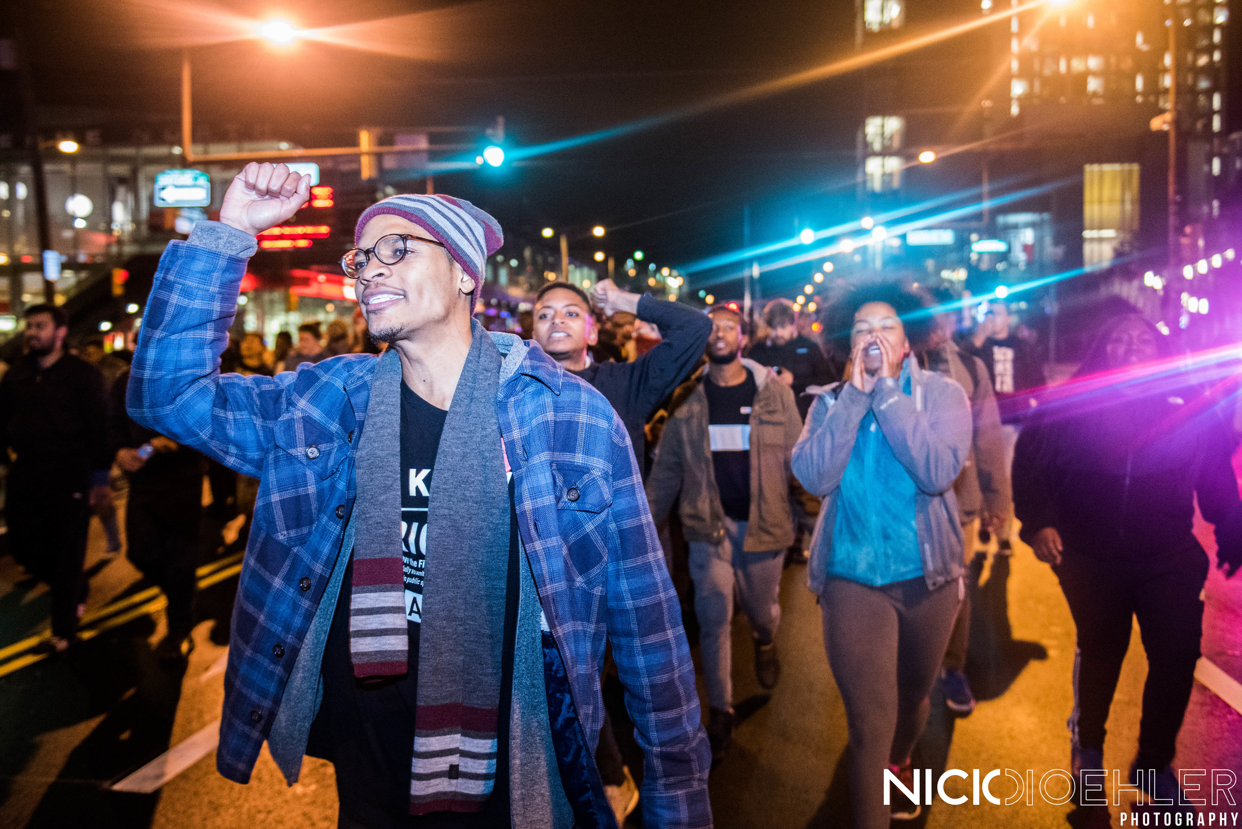 Fists raised high while chanting against President-Elect Donald Trump.
