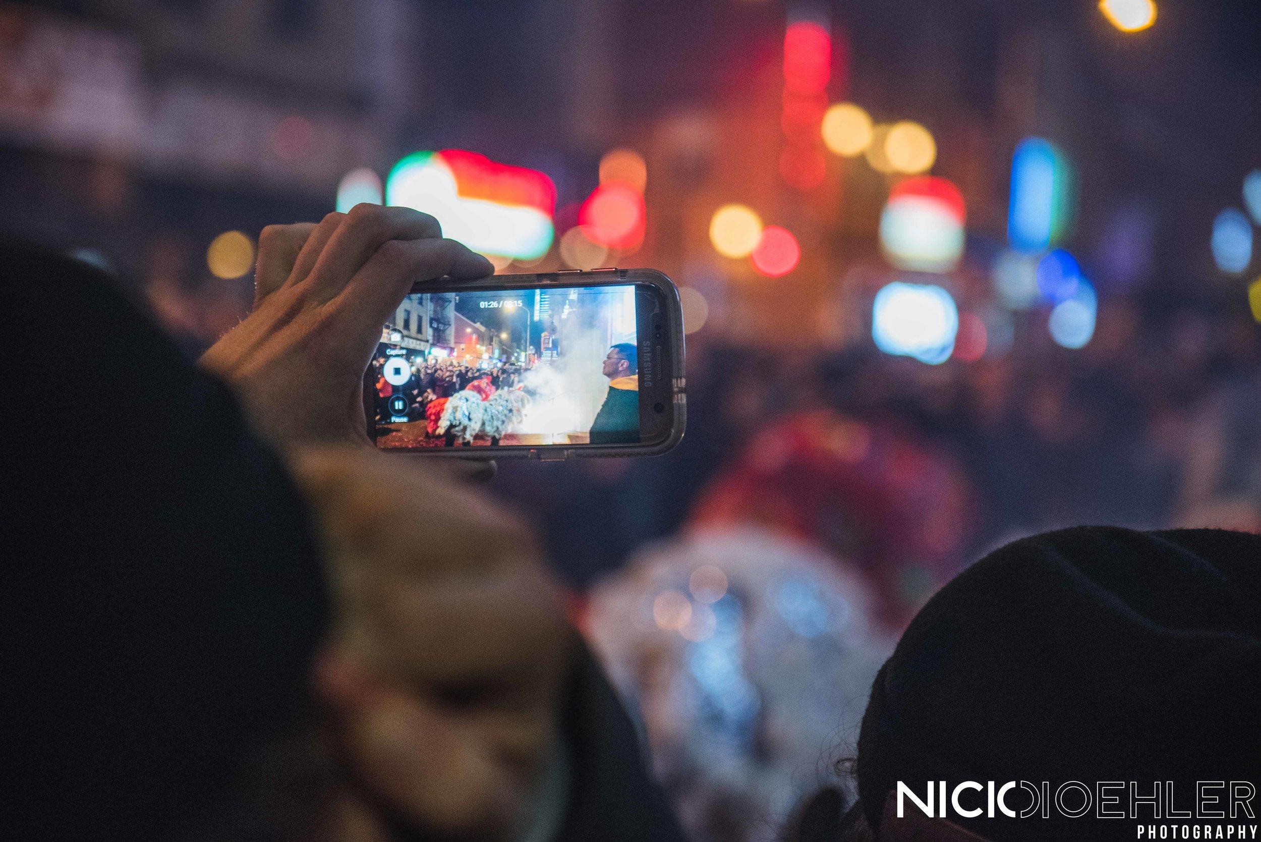 Lion Dancers through a phone.