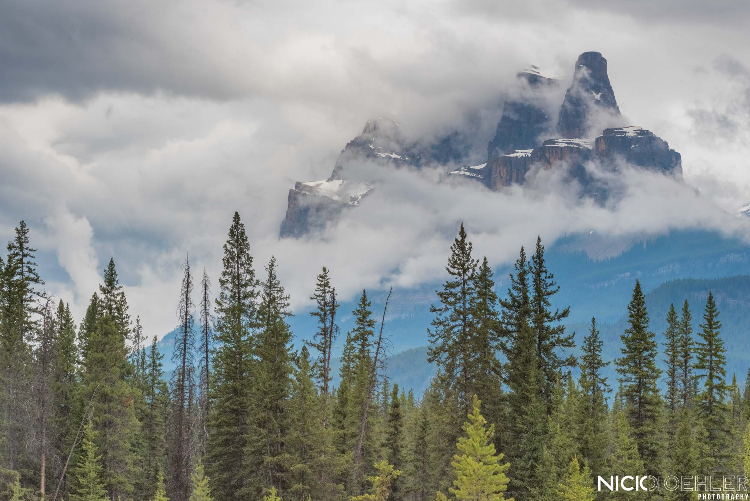 Banff National Park: Mountains get swallowed in clouds.