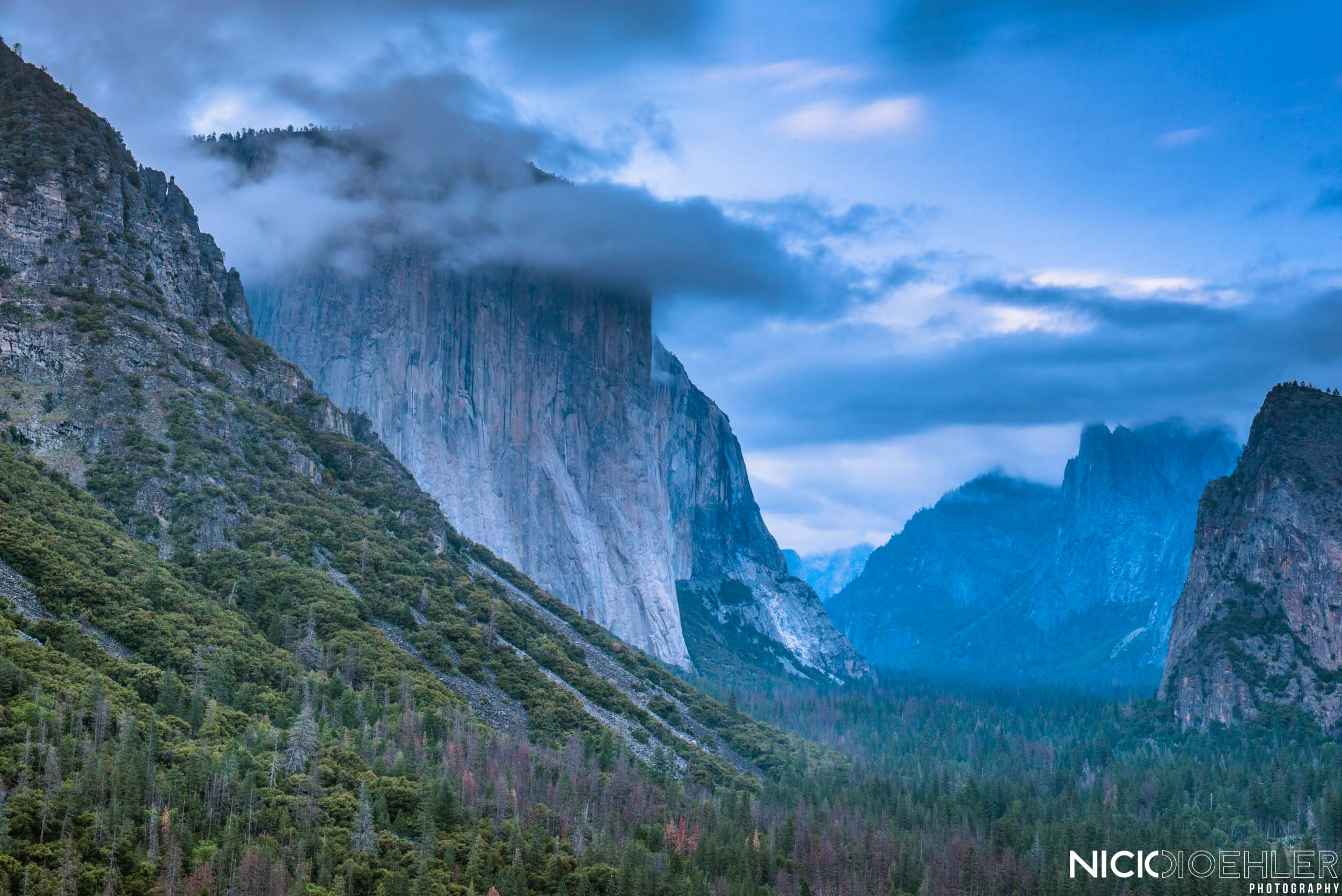 Yosemite National Park: El Capitan being masked by the moody clouds.