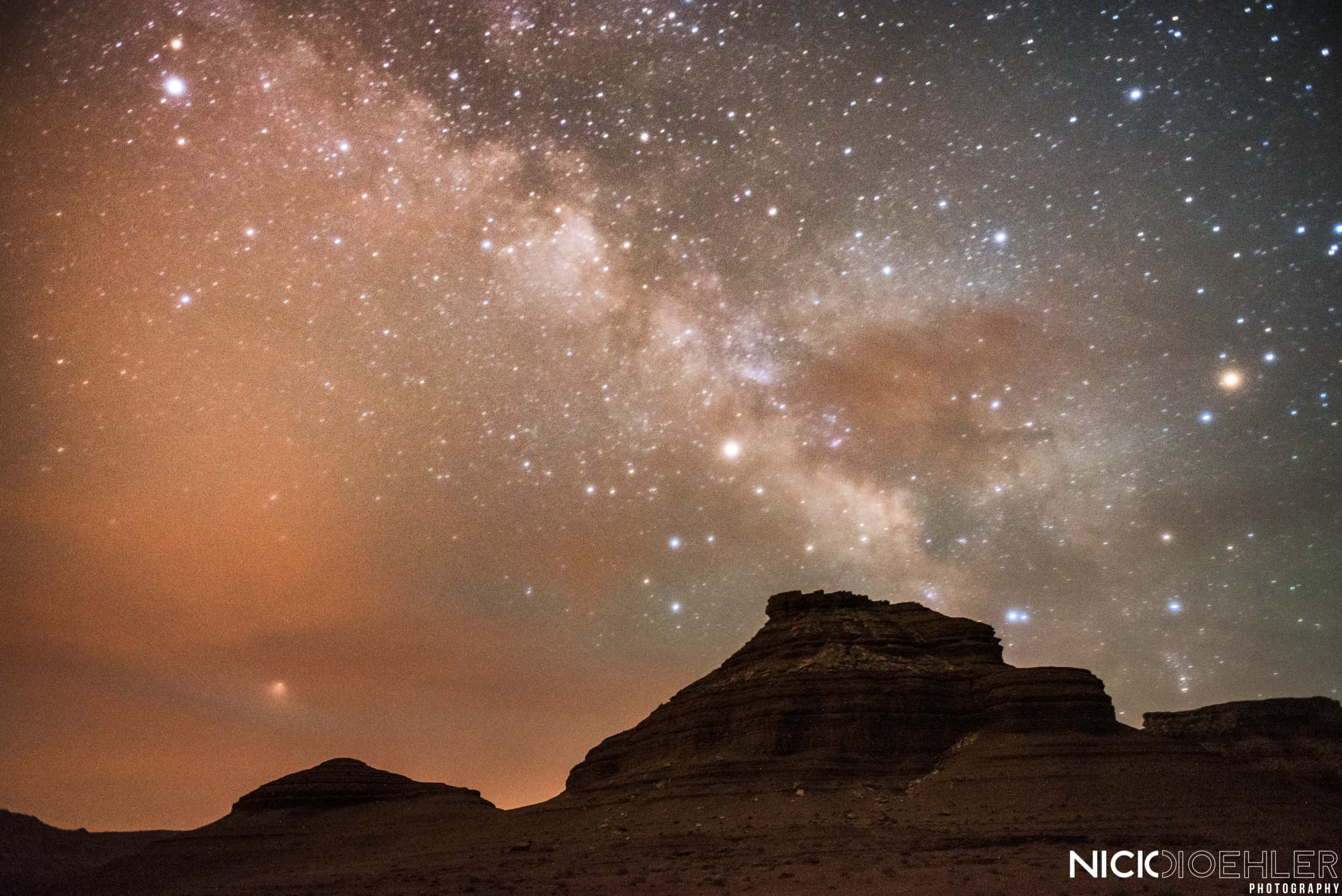 Grand Canyon National Park: The Milky Way across the cloudy sky.