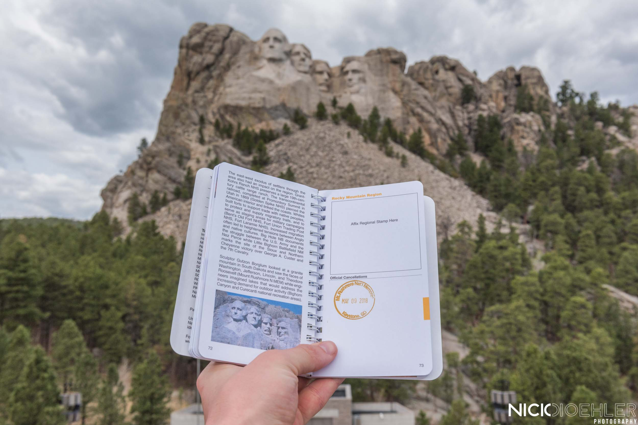 Mount Rushmore: Holding my passport book in front of a great historical monument.