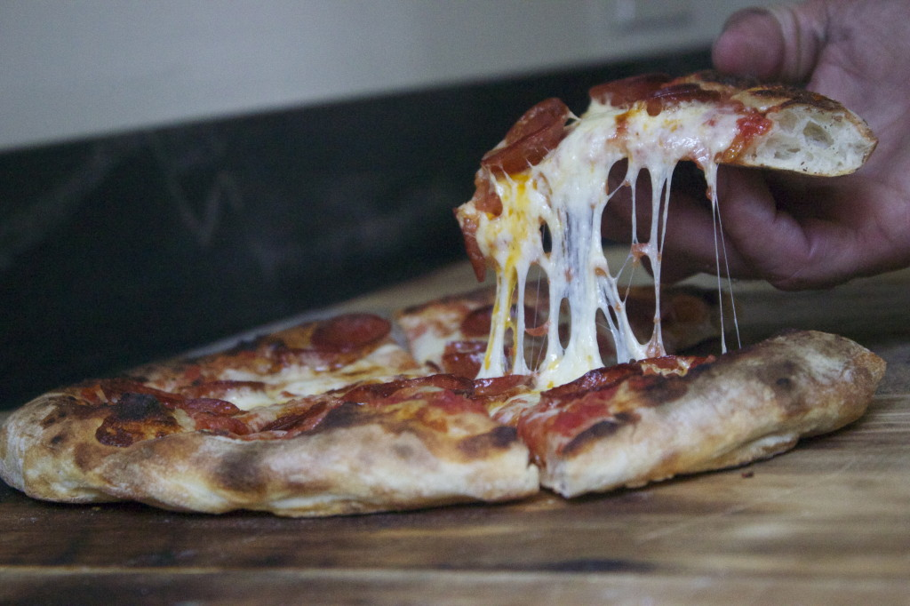 grabbing a slice, just look at that cheese
