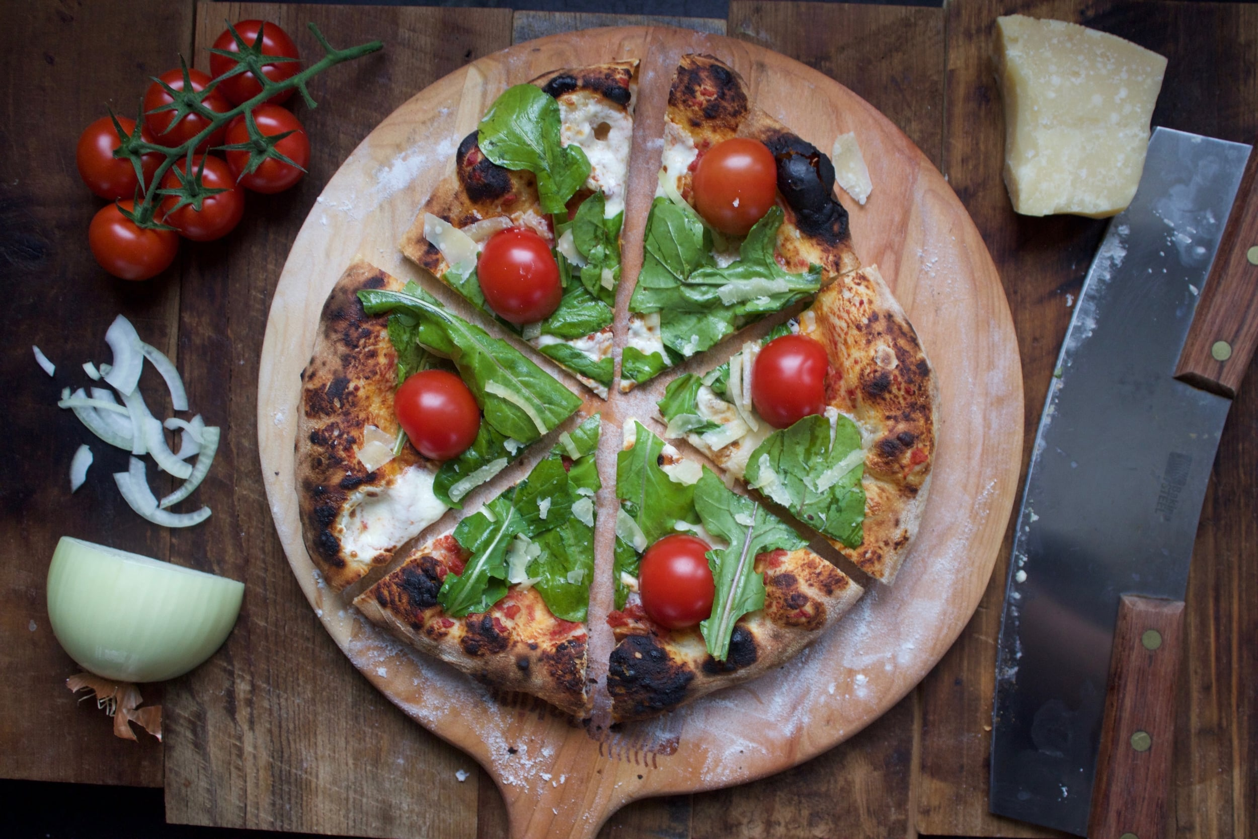 arugula and vine tomatoes on a Baking Steel pizza
