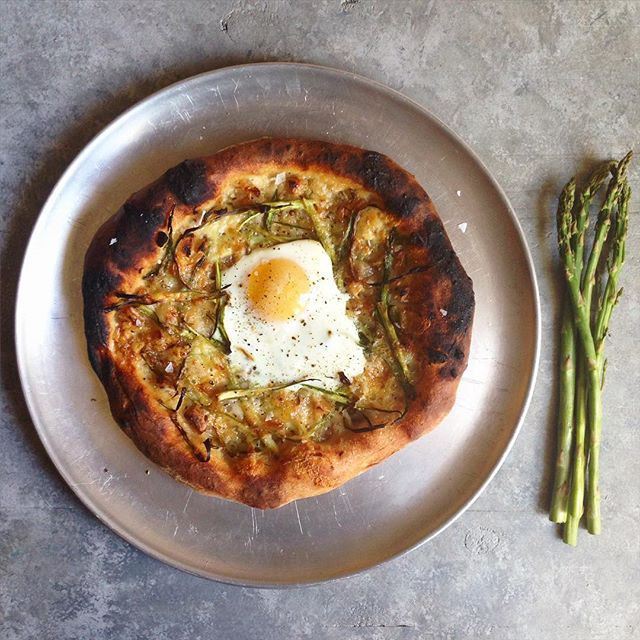 @rainydaybites  with the classic egg pizza!