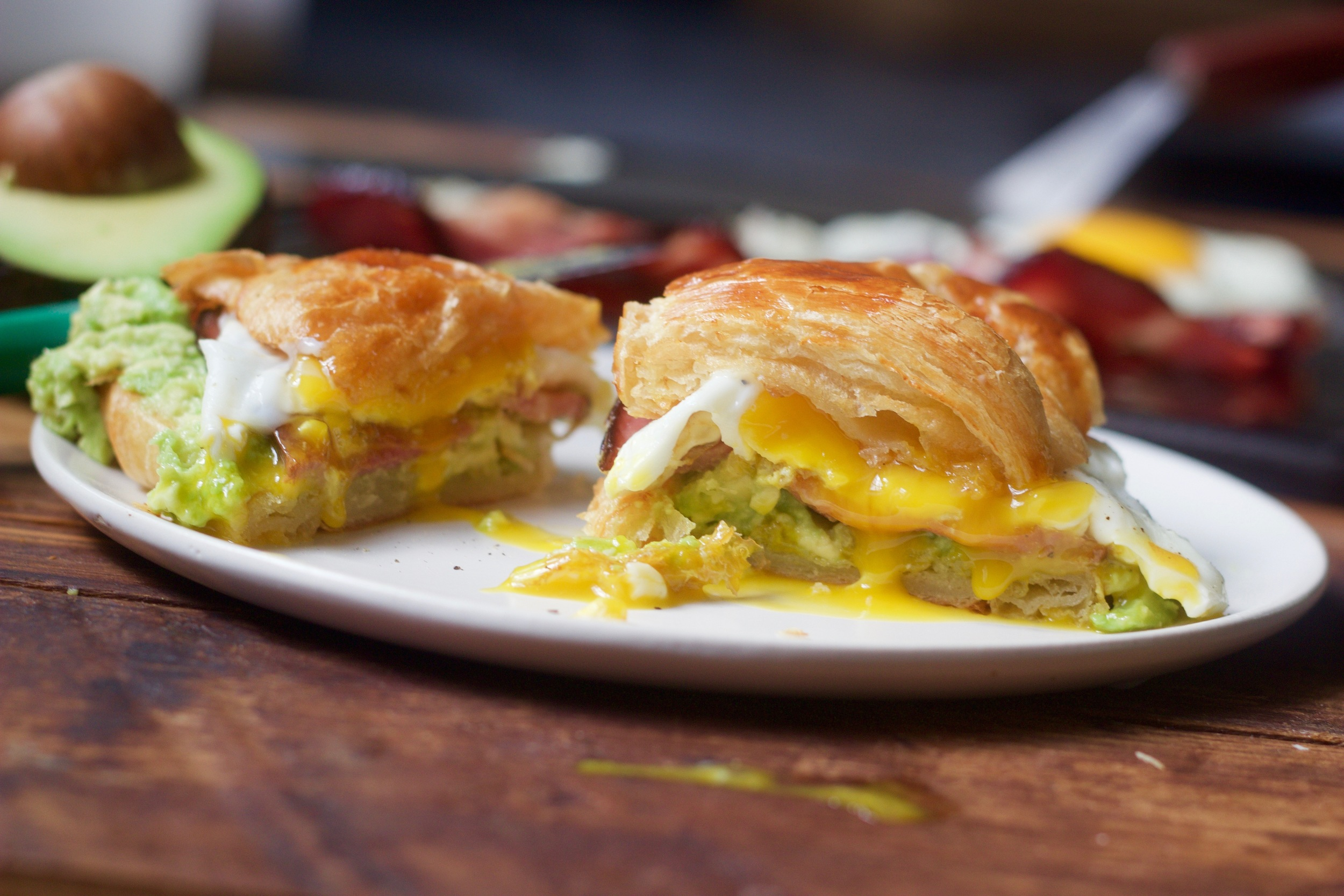 croissant with egg, avocado and Canadian Bacon