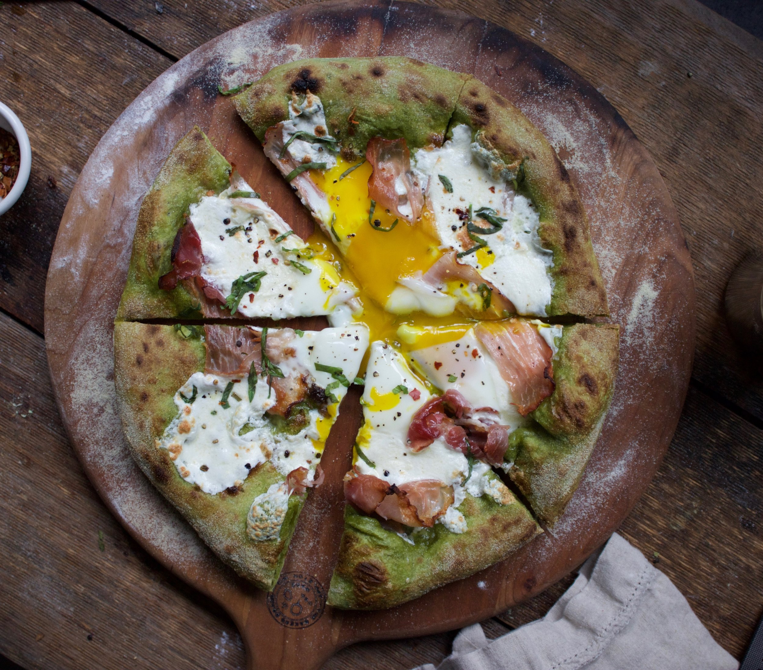 spinach pizza with eggs