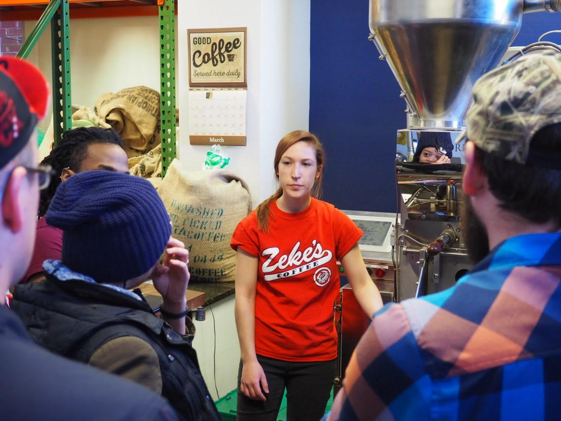 Samantha from Zeke's showing the team the roasting process