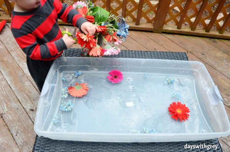 preschool sensory bin with flowers