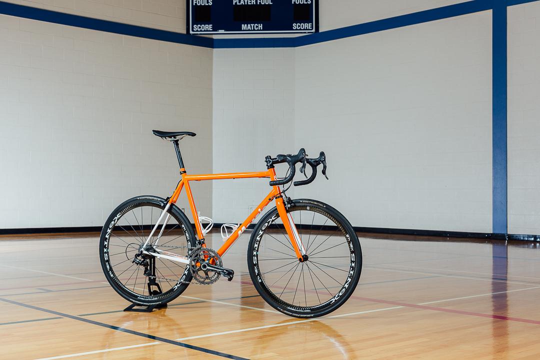 Full driveside view of Eryn's Syracuse University Orangemen themed Mosaic Bespoke Bicyle