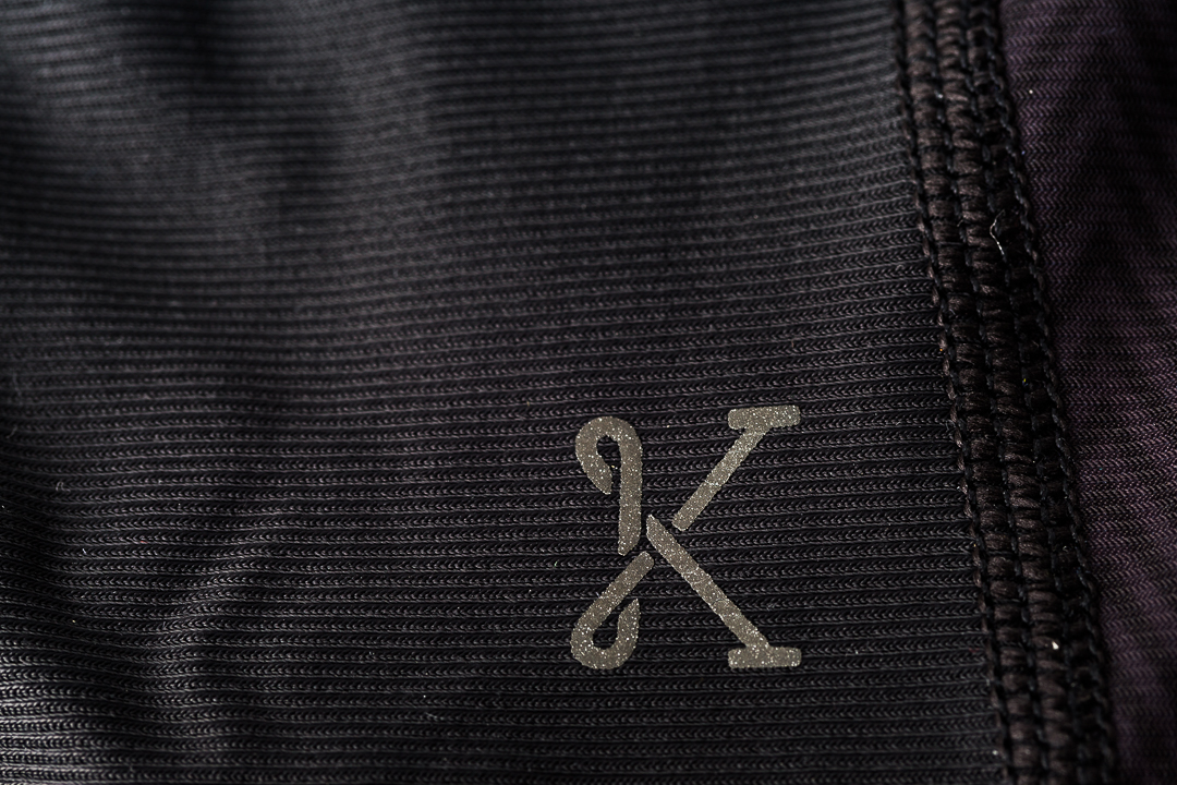Discreet reflective ink logo branding on the Kitsbow knee warmers for road cycling