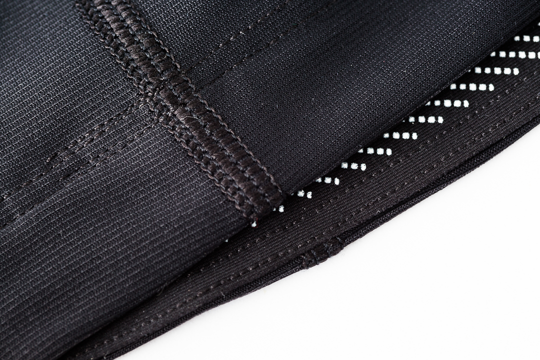 White herringbone patterned silicone gripper on the Kitsbow knee and arm warmers for road cycling.