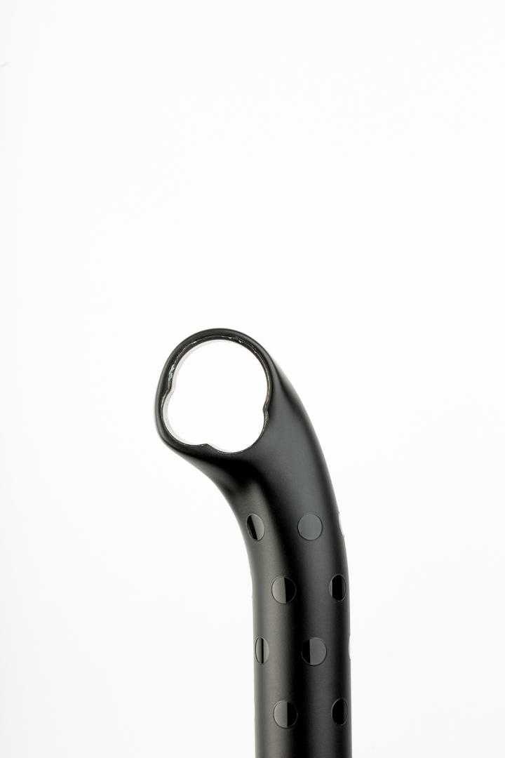 Matte black with gloss black polka dots on an ENVE setback seatpost - side view