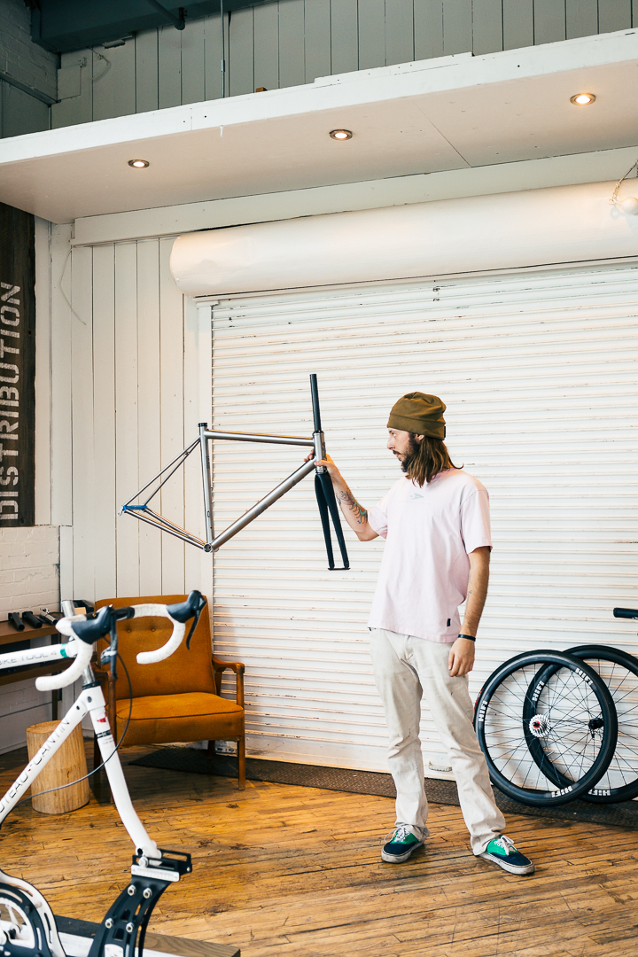An artist inspects the canvas before the work begins. Jesse looks over the Mosaic RT-1 frameset ahead of build day.