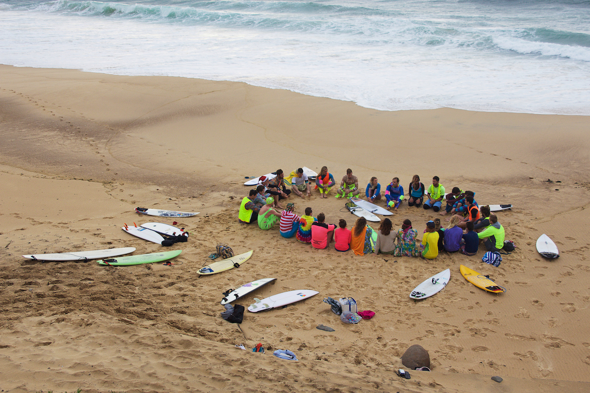 Fluoro Fridays start with a 5-10 minute chat on the sand before the surfing and yoga get underway, Everyone's invited to share something, but we mostly just listen.