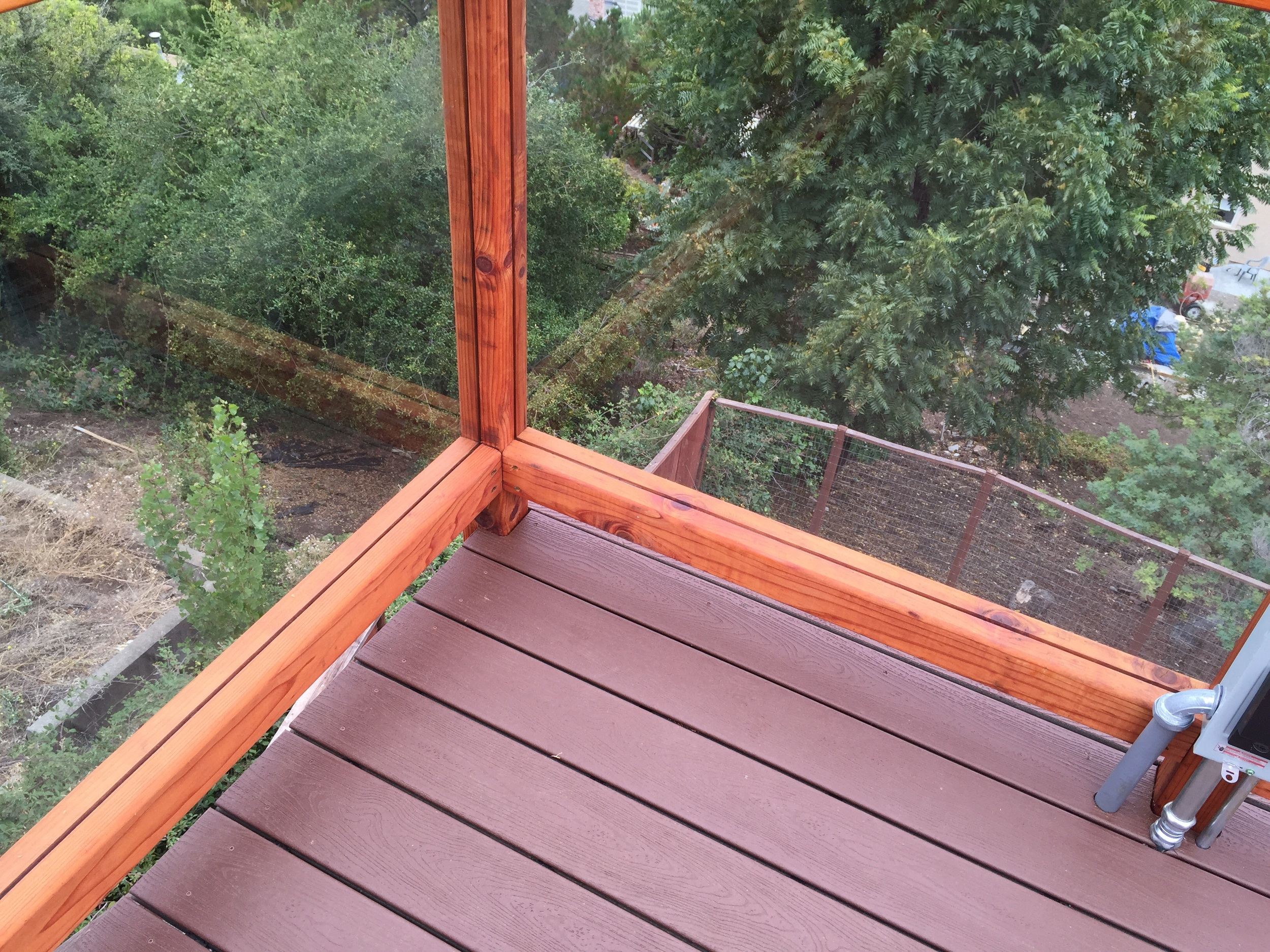 """3/8"""" tempered glass panels Sit nicely in the grooves I ripped in the redwood posts and bottom rails."""