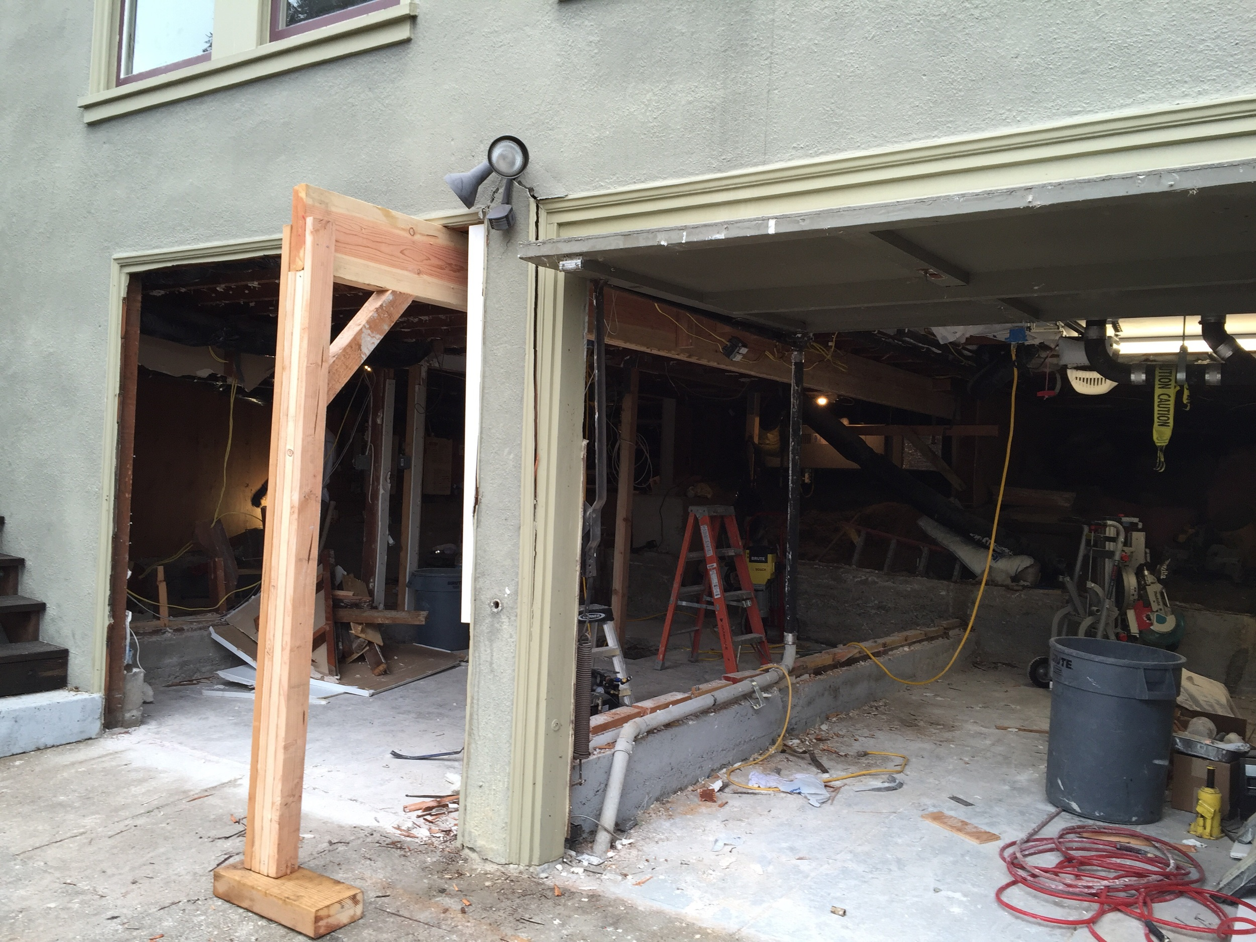 """""""Garage with slab""""we put up a few temporary beams because we removed some walls."""