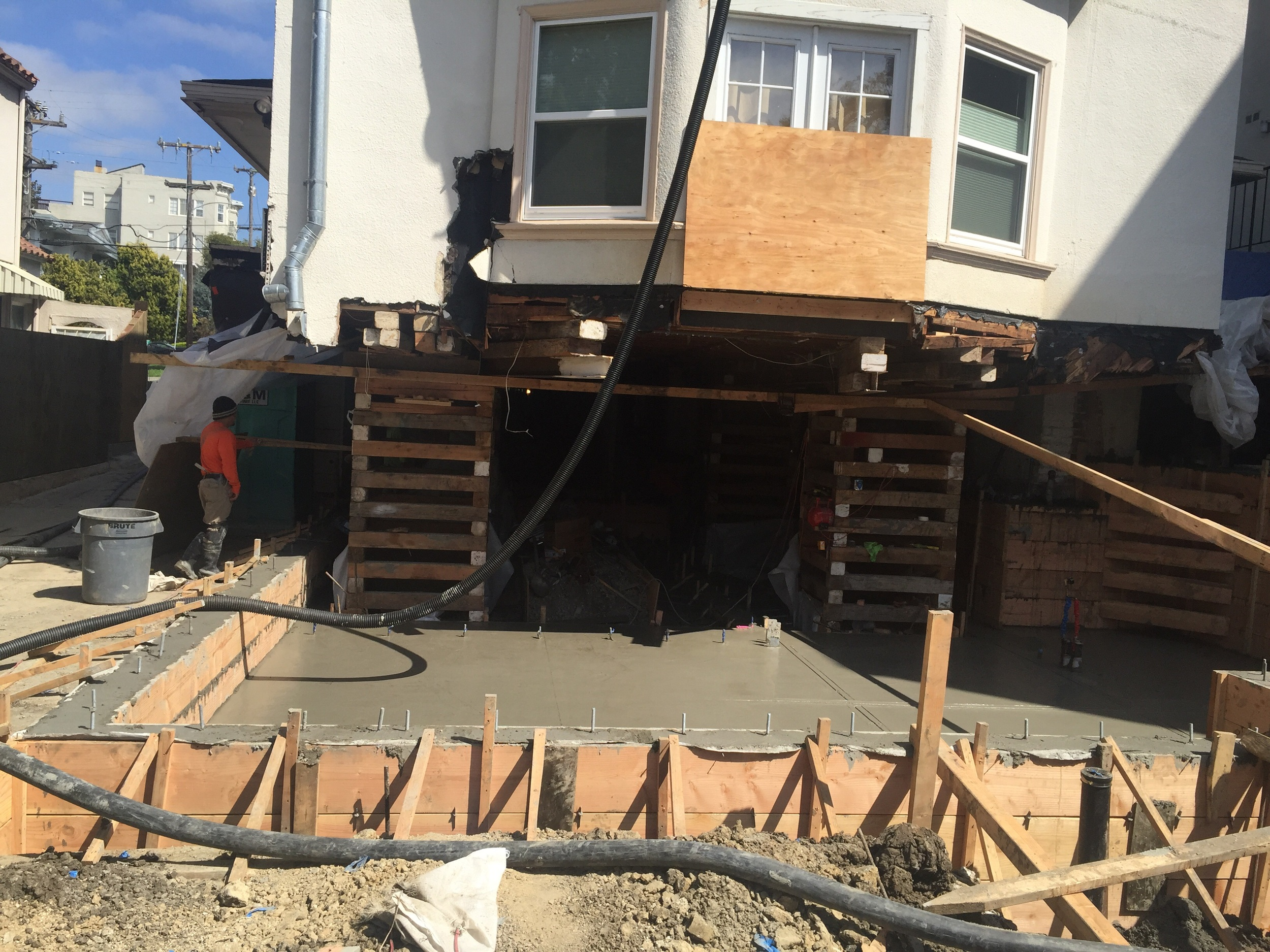 New foundation and slab for floor of lower unit.