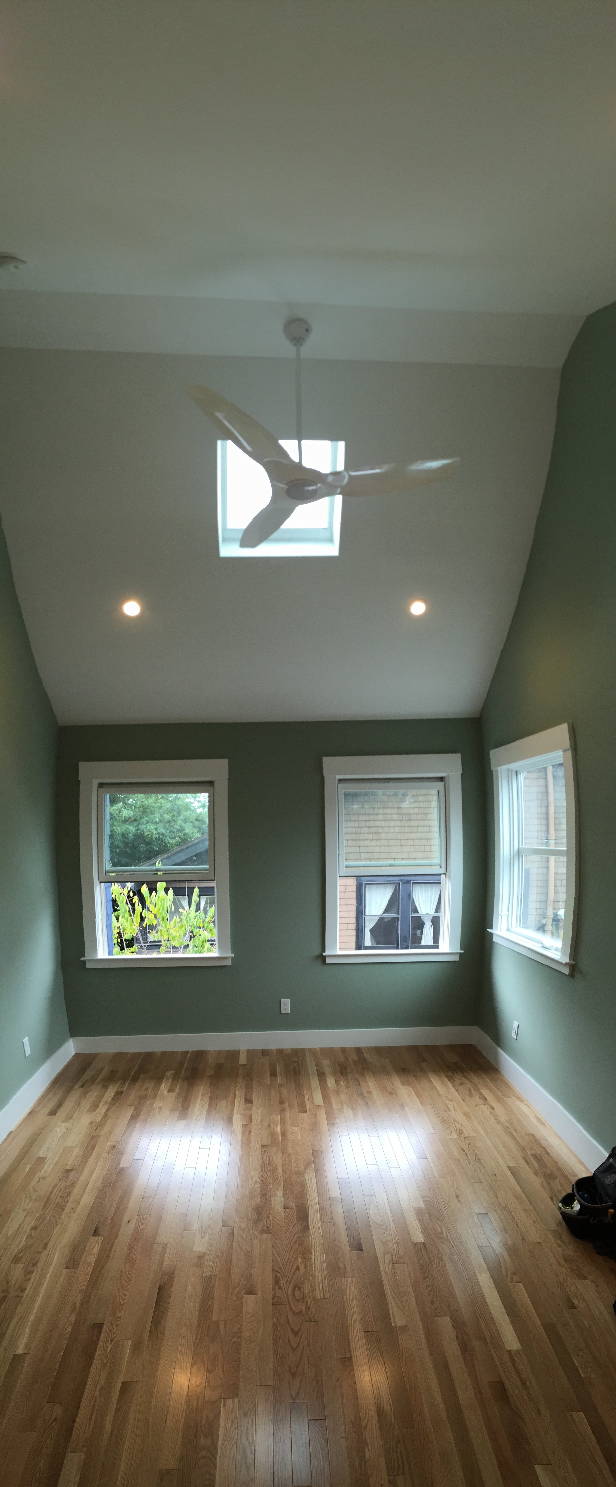 Vaulted ceiling in bedroom for open feel.