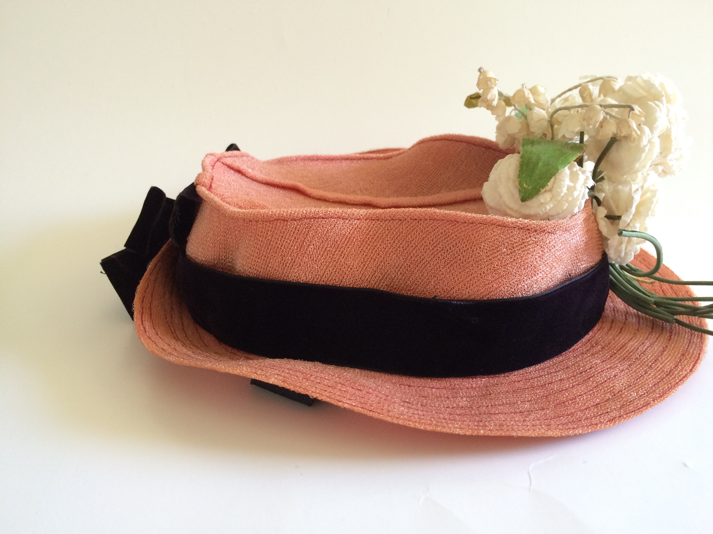 Fantastic vintage pink hat from the 1930s or 1940s with a velvet bow and silk flowers.