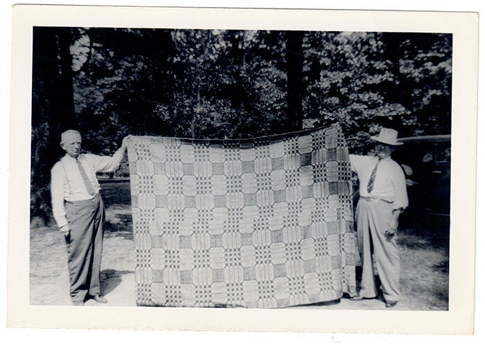 Counterpane (bed cover) woven by Almarinda Smith Terry held up by Monroe Hatfield & Floyd Terry (Monroe & Floyd were 1st cousins.)