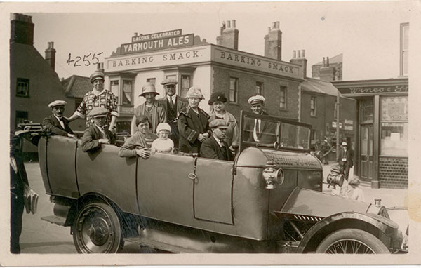"11 July 1926 ""Your Aunt Lizzie and I just leaving Yarmouth for Newmarket"". Taken at Great Yarmouth Gorleston-on-Sea in front of the Lacons Celebrated Yarmouth Ales Barking Smack. Alice is in the back row, second from right. Next to her is her brother William's wife, Elizabeth Thomas."