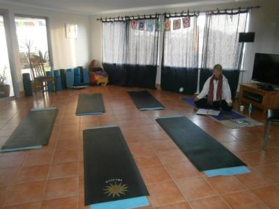 Yoga Room at Fisherman's Lodge, Maitraya. Helen preparing for a retreat yoga class.