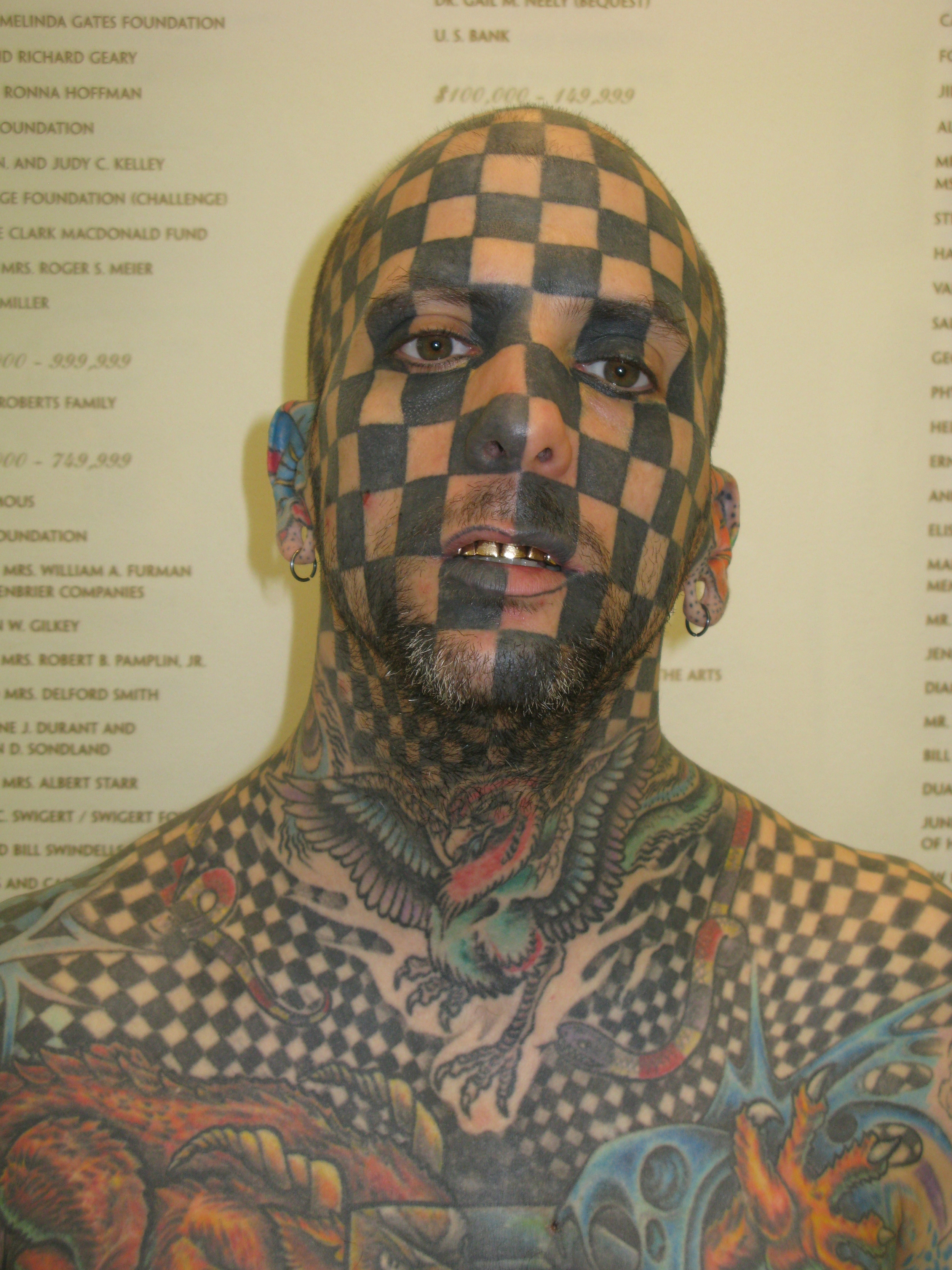 2010, Man in Portland at a tatoo art show.  I asked if I could take a few photos of him and he agreed.