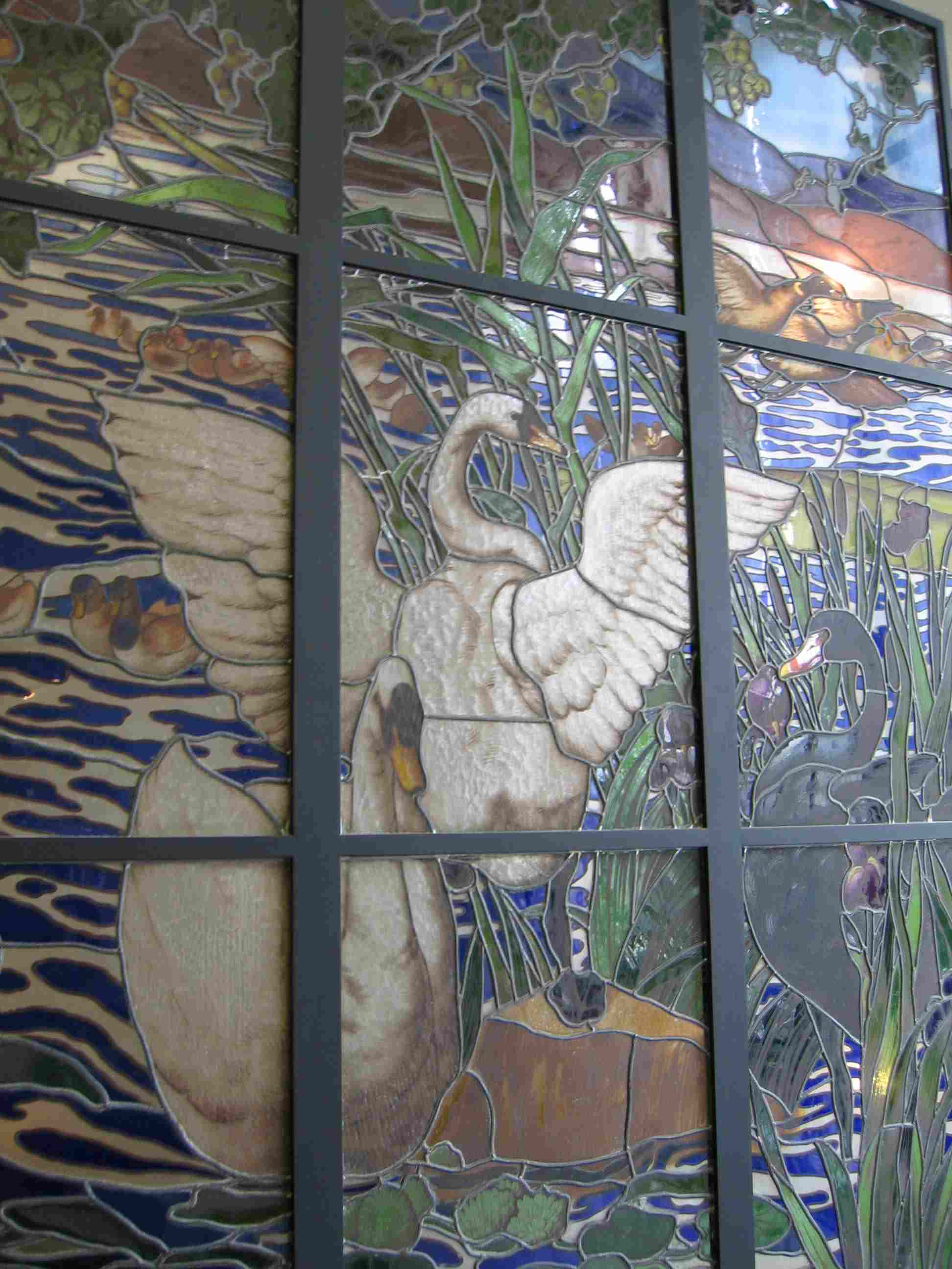 Glass piece at Musse D'Orsay in Paris.  What I love about this work is that instead of having lead between two different colors, in late 19th century there are two adjacent colors with no lead in between.  That happens in the water section where there is blue and white. This influenced my desire to dofused glass works.