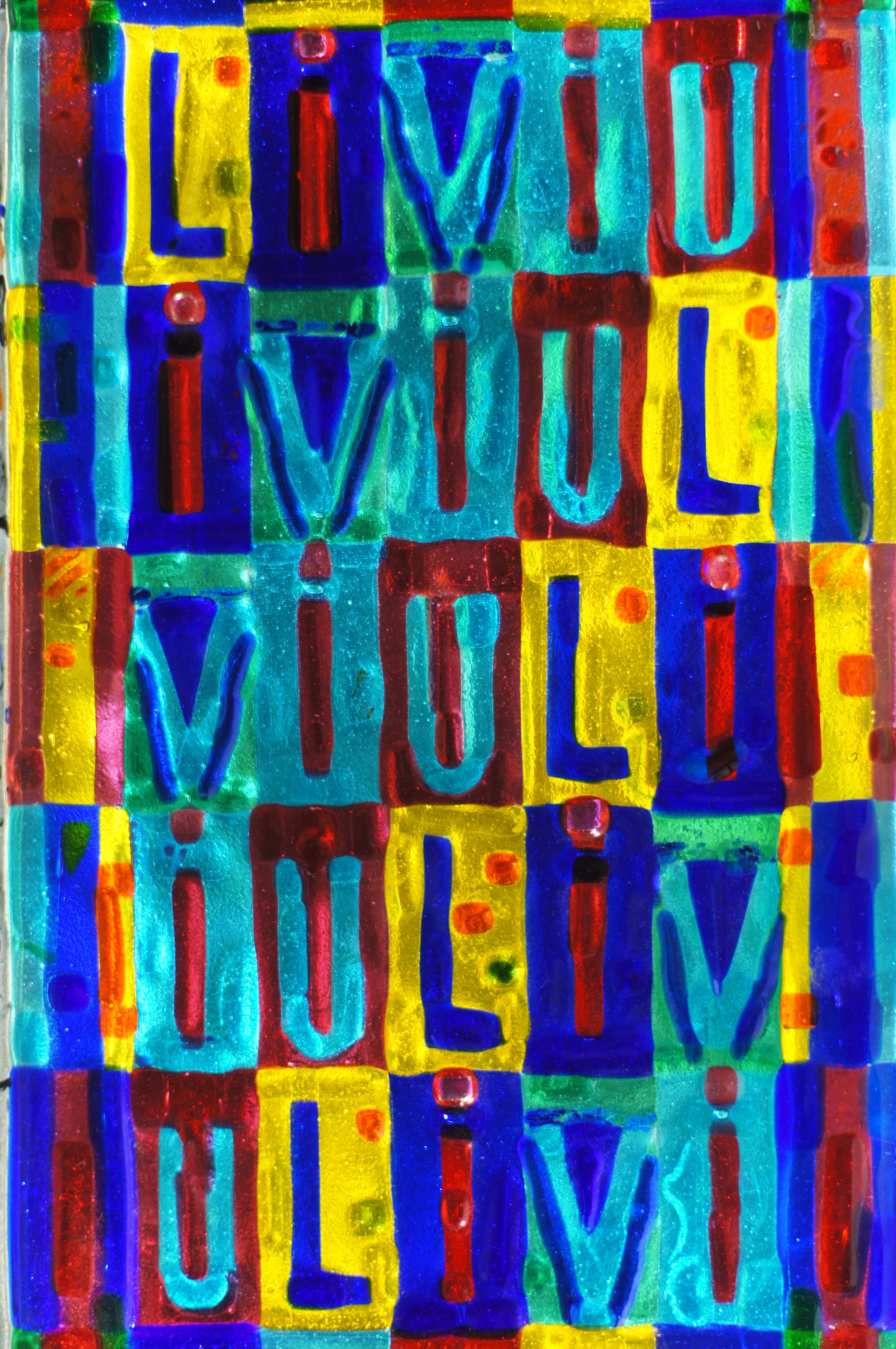 Play on the letters 'Liviu,' which are rotated around.     2010    Fused glass.