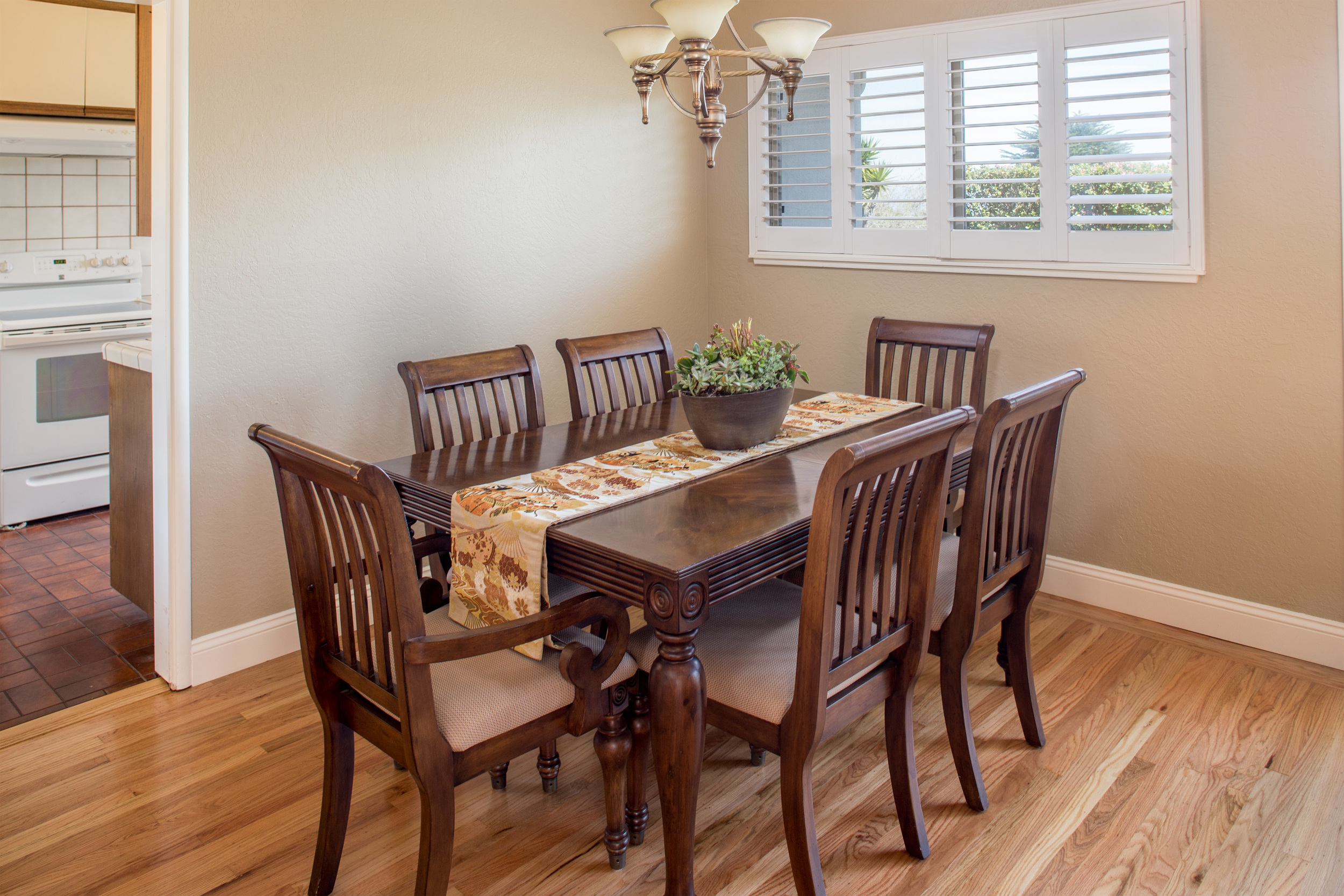 5-Dining room with newly refinished hardwood floors and plantation shutters.jpg